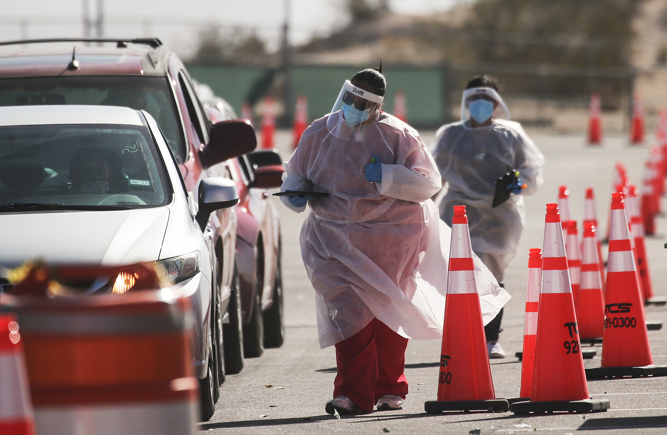 Healthcare workers greet incoming vehicles at a drive-in Covid-19 testing site in El Paso, Texas, on November 14.