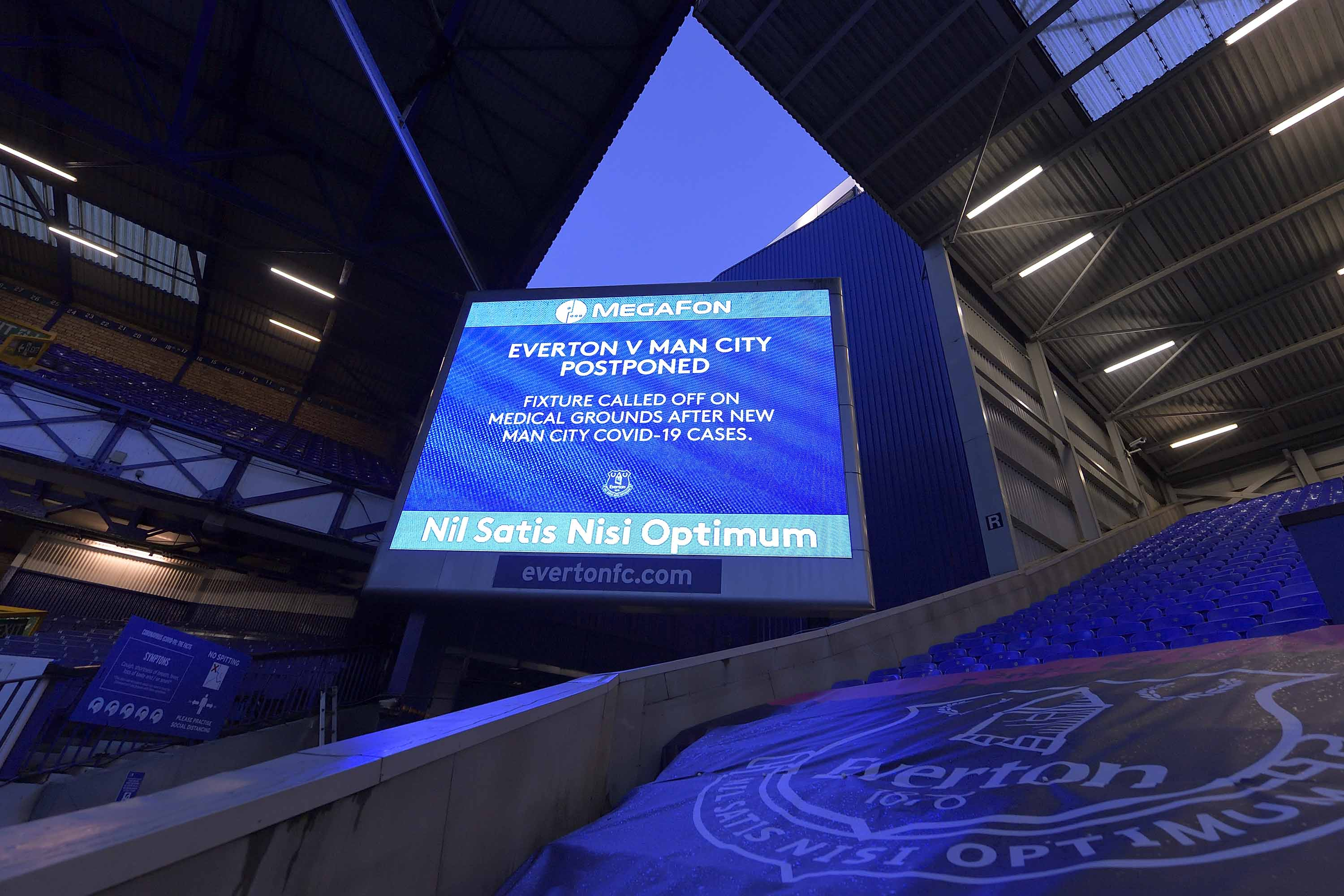 A notice announcing the postponement of the Premier League match between Everton and Manchester City in Liverpool, England, on December 28.