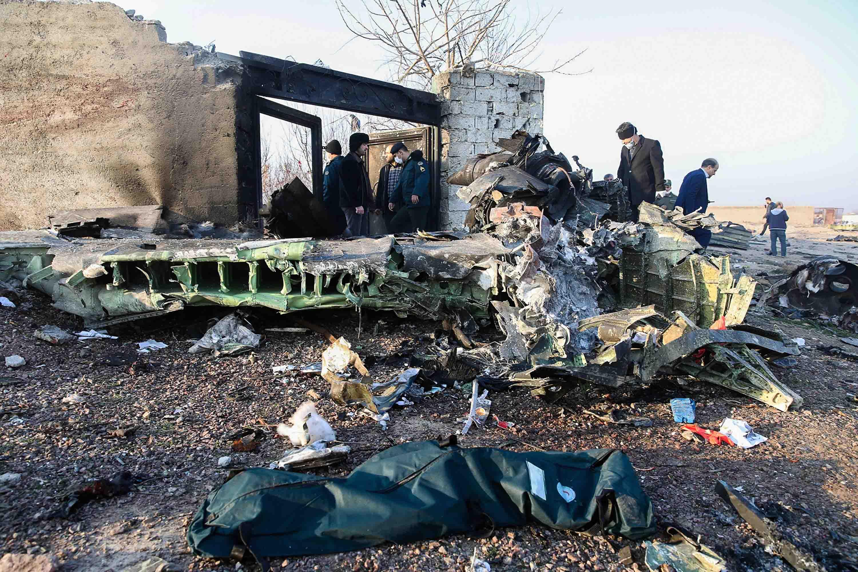 Authorities work near the wreckage of the Ukrainian plane on Wednesday.