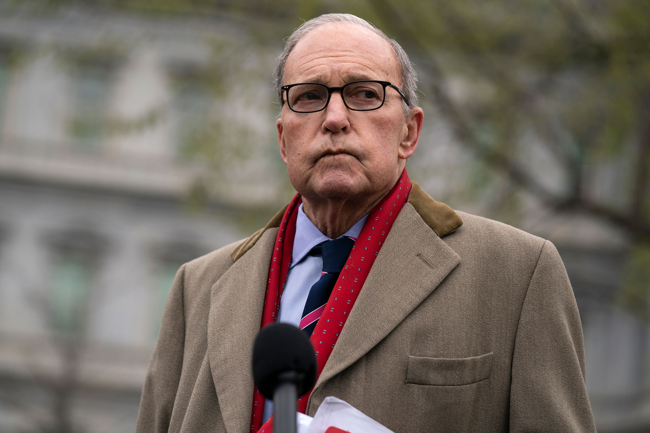 White House economic adviser Larry Kudlow talks with reporters at the White House on Tuesday, March 24.