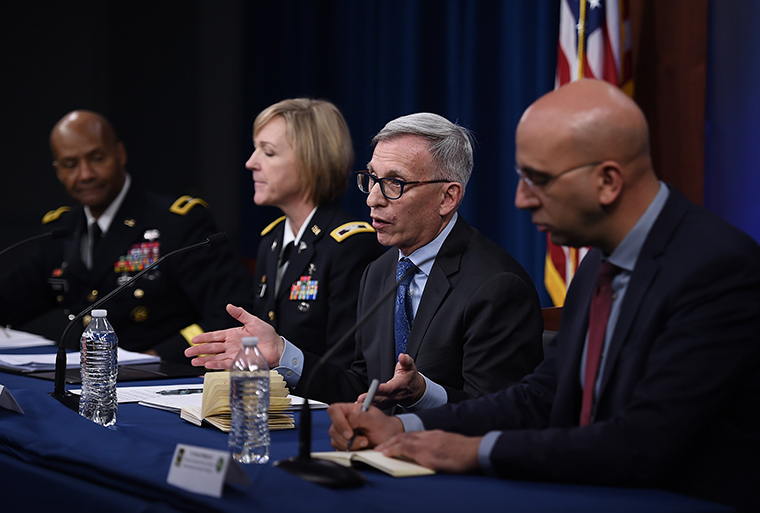 Dr. Nelson Michael, director of the Center for Infectious Diseases Research at Walter Reed Army Institute of Research,second from right, speaks during a news conference on the coronavirus at the Pentagon on Thursday.