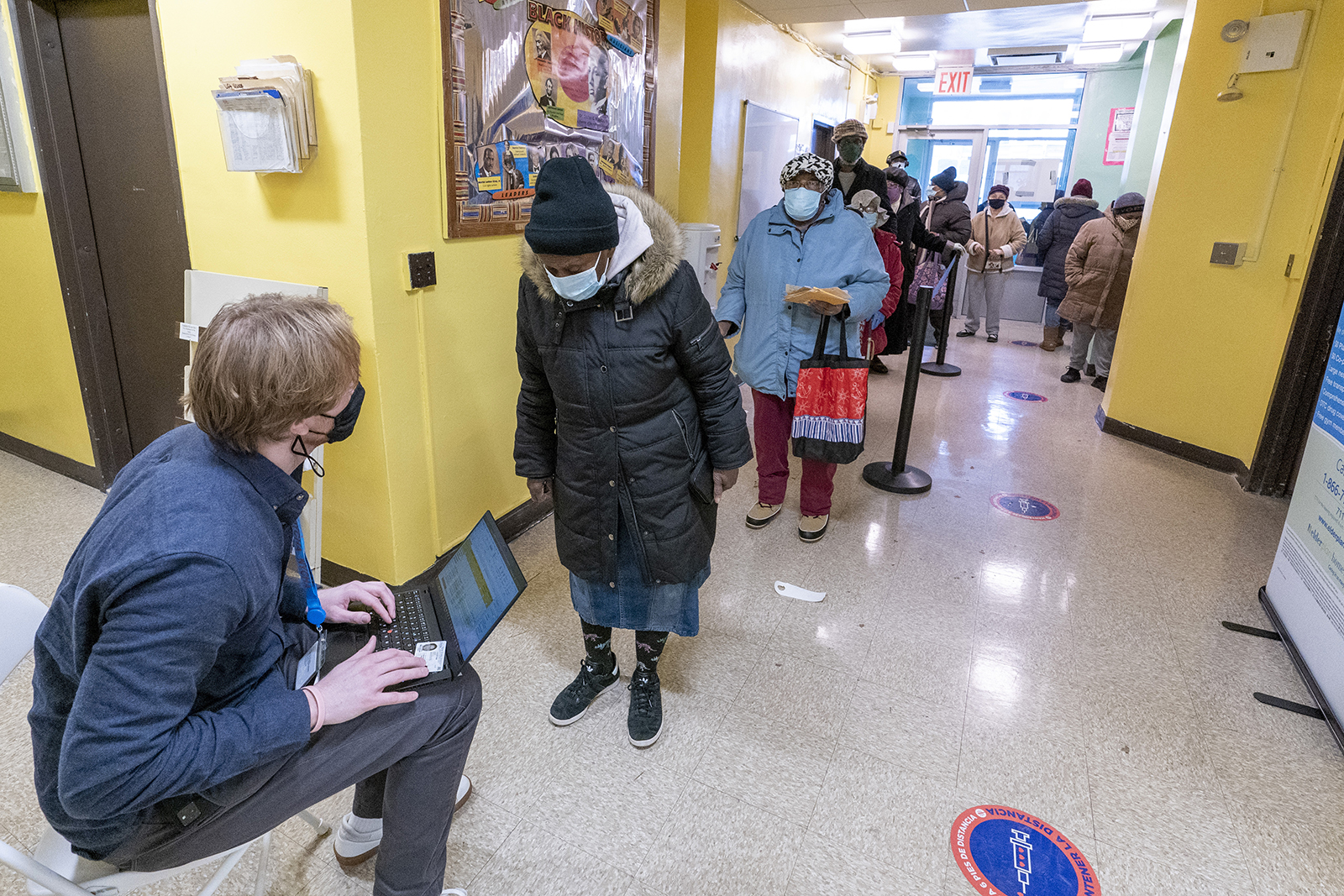 A screener registers residents of the William Reid Apartments at a Covid-19 pop-up vaccination site at the NYCHA housing complex on Saturday, January 23, in Brooklyn, New York.