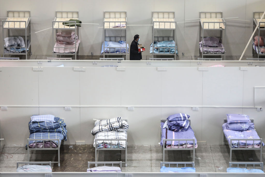 Workers convert the Wuhan International Conference and Exhibition Center into a field hospital amid the novel coronavirus outbreak on February 4.