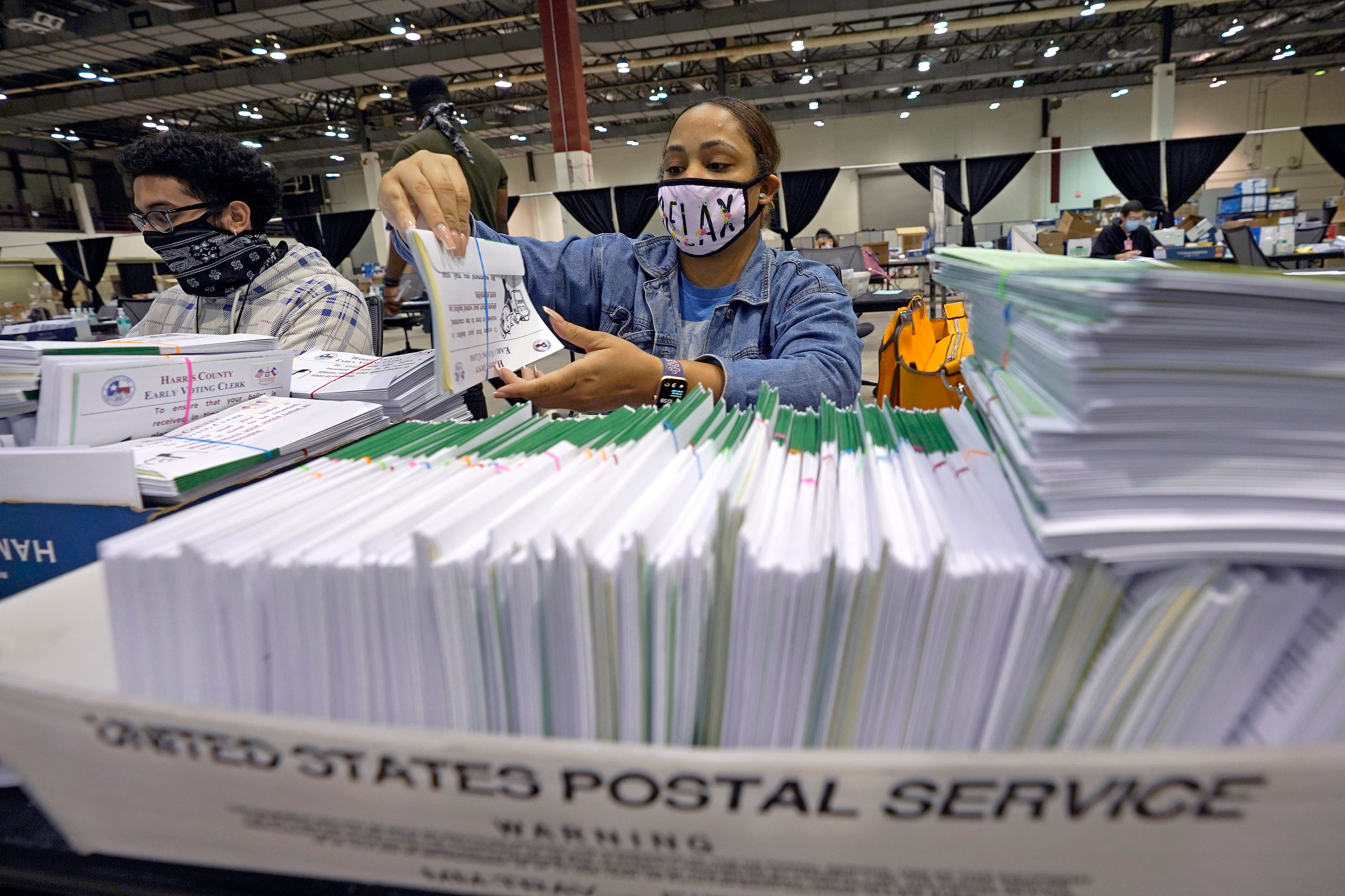 A Harris County election worker prepares mail-in ballots to be sent out to voters September 29 in Houston, Texas.