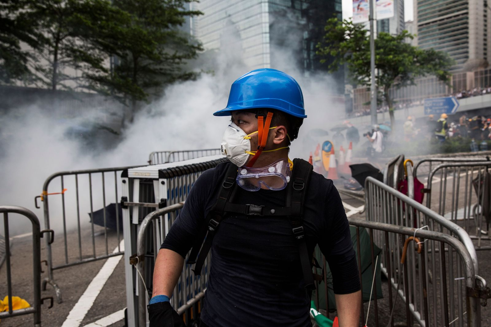 A protester wearing a mask reacts after police fired tear gas during demonstrations outside the Legislative Council Complex in Hong Kong on June 12.