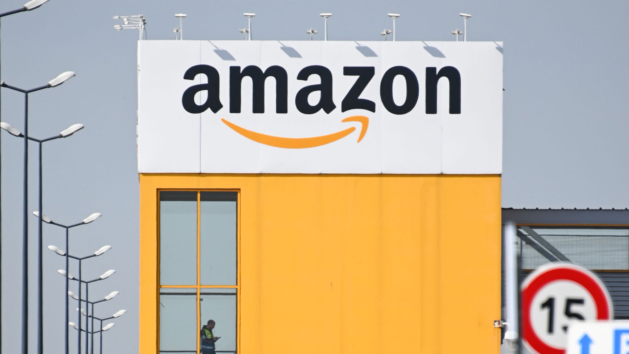 An Amazon employee is seen at the Amazon logistics center in Lauwin-Planque, France, on April 16.