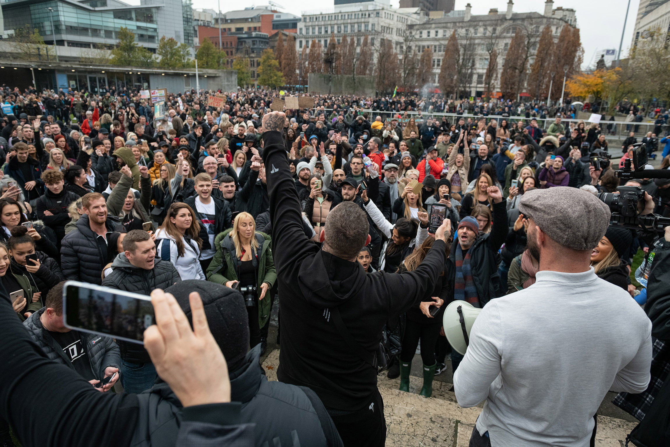 Protesters gather at St Peters Square during an anti-lockdown protest in Manchester, England on Sunday, November 8.
