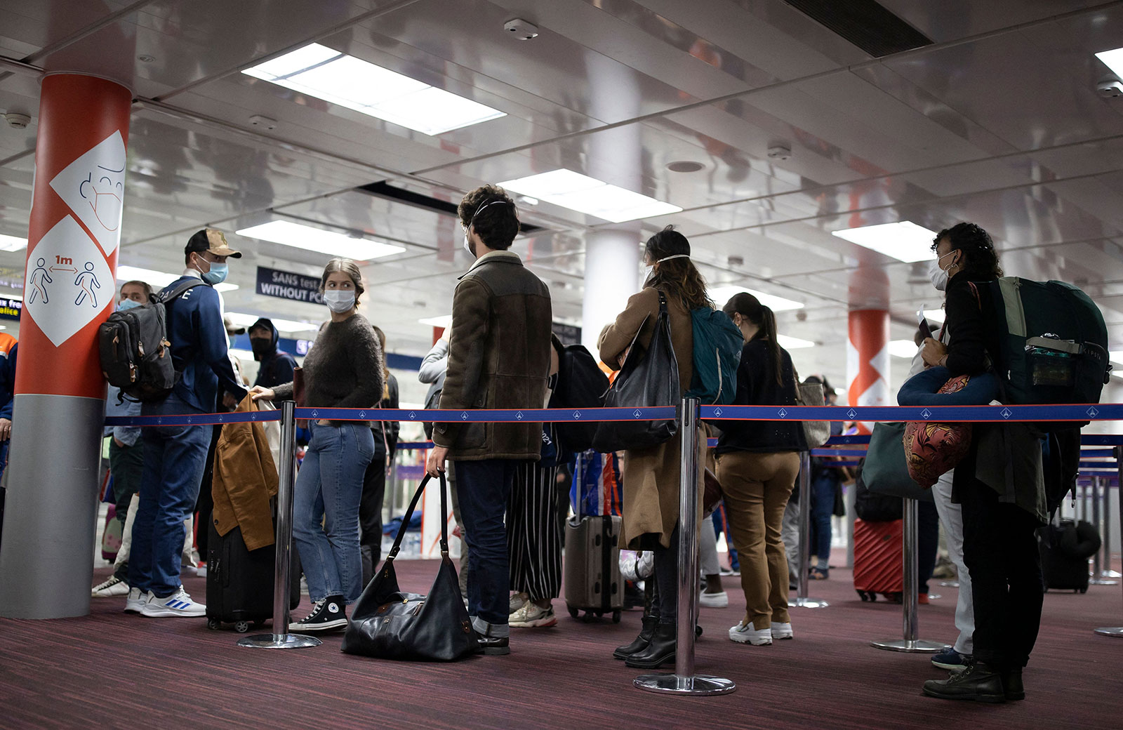 Passengers line up at the passport control area of Paris Charles de Gaulle Airport on April 25.