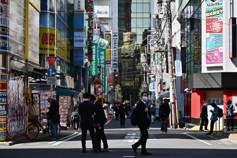 People walk in a street in Tokyo's Akihabara area on April 24.
