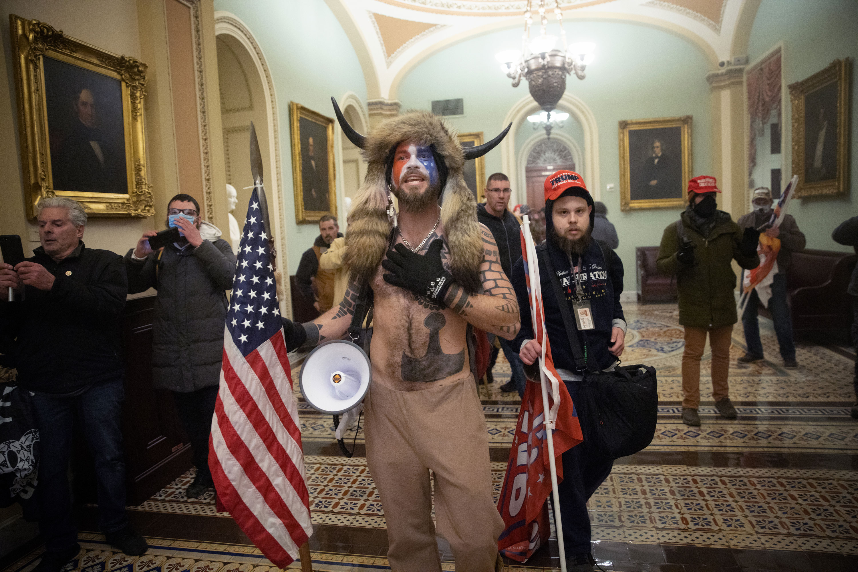 Jacob Anthony Chansley, also known as Jake Angeli, confronts Capitol Police outside the Senate Chamber on January 6.