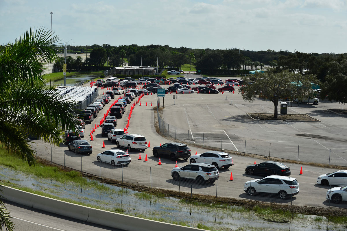 Cars wait in line at the coronavirus drive-in testing site at the Hard Rock Stadium's parking lot in Miami Gardens, Florida on November 3.