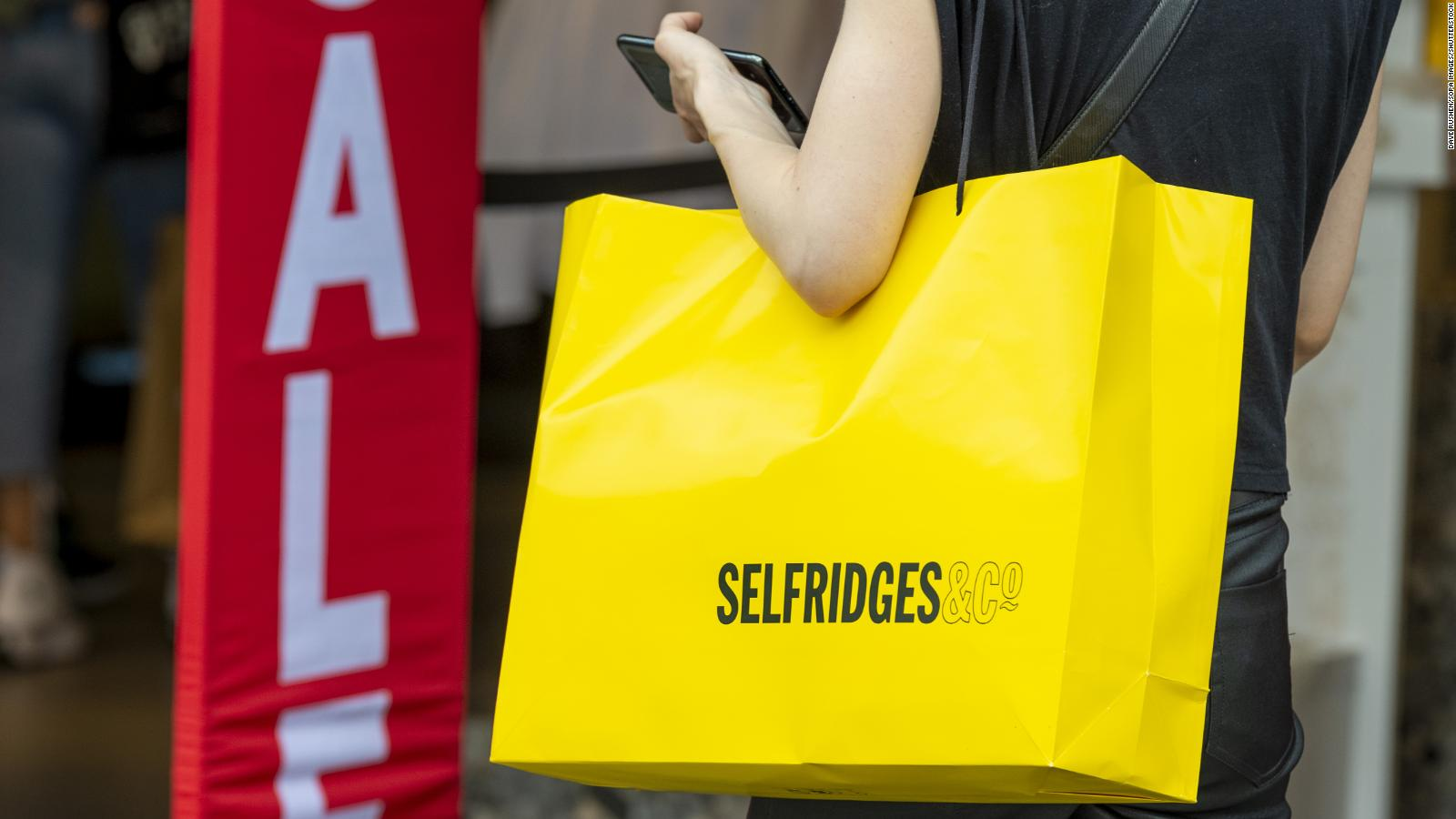 A woman is seen holding a Selfridges shopping bag in London, on June 15.