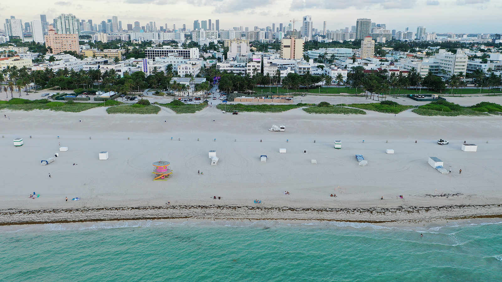 An aerial drone view as beachgoers take advantage of the opening of South Beach on June 10 in Miami Beach.
