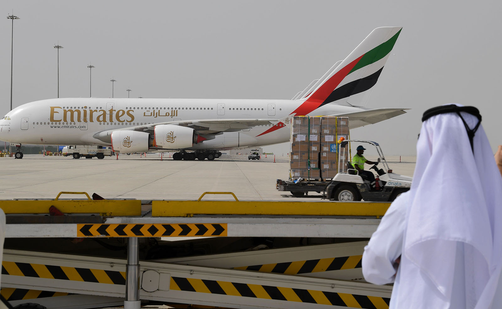 Tonnes of medical equipment and coronavirus testing kits provided by the World Health Orgnization are pictured passing by an Emirates airlines Airbus A380-861, at the al-Maktum International airport in Dubai on March 2.