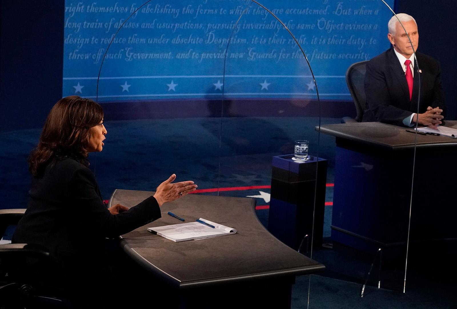 Vice President Mike Pence listens as Democratic vice presidential nominee Kamala Harris speaks during the vice presidential debate on Wednesday in Salt Lake City.
