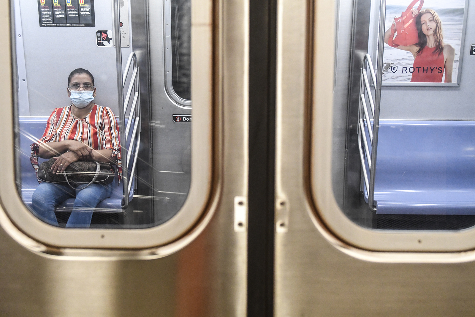 A woman wearing a mask commutes on the subway in the Brooklyn borough on June 22, in New York City.