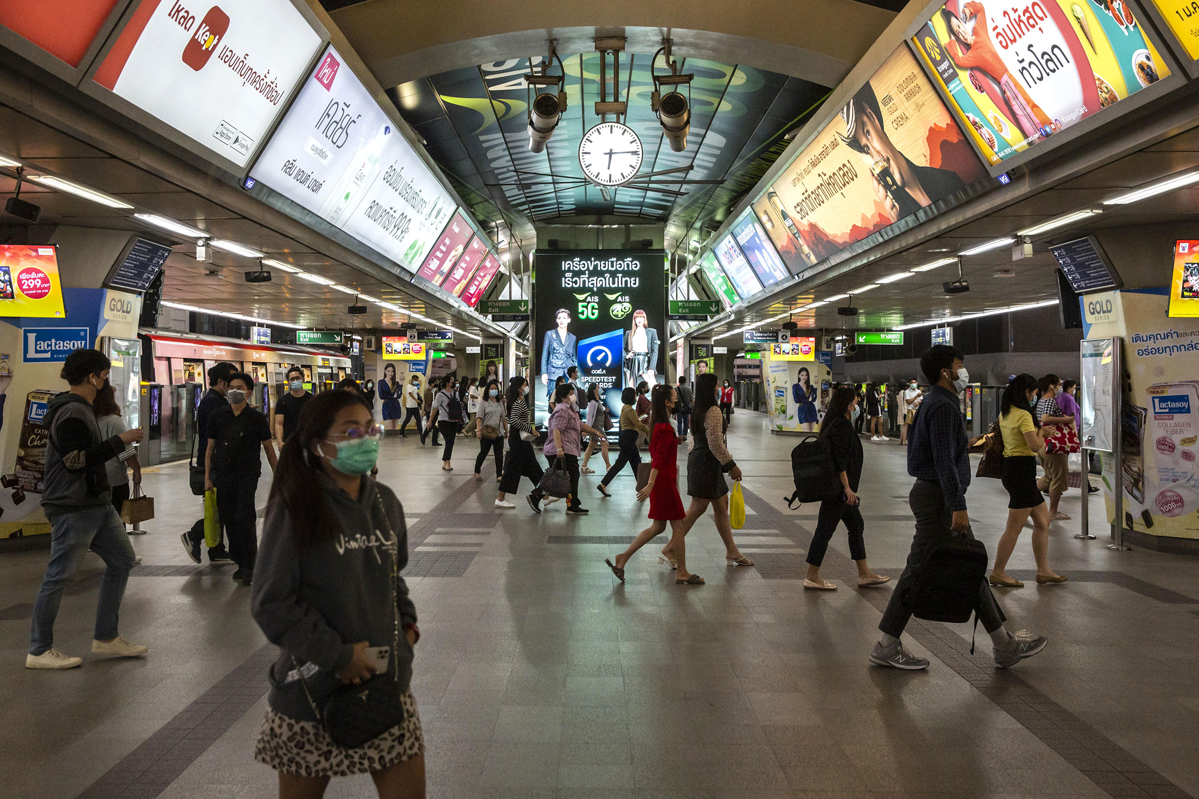 Commuters walk through Siam BTS Station in Bangkok, Thailand, on Monday, January 4.