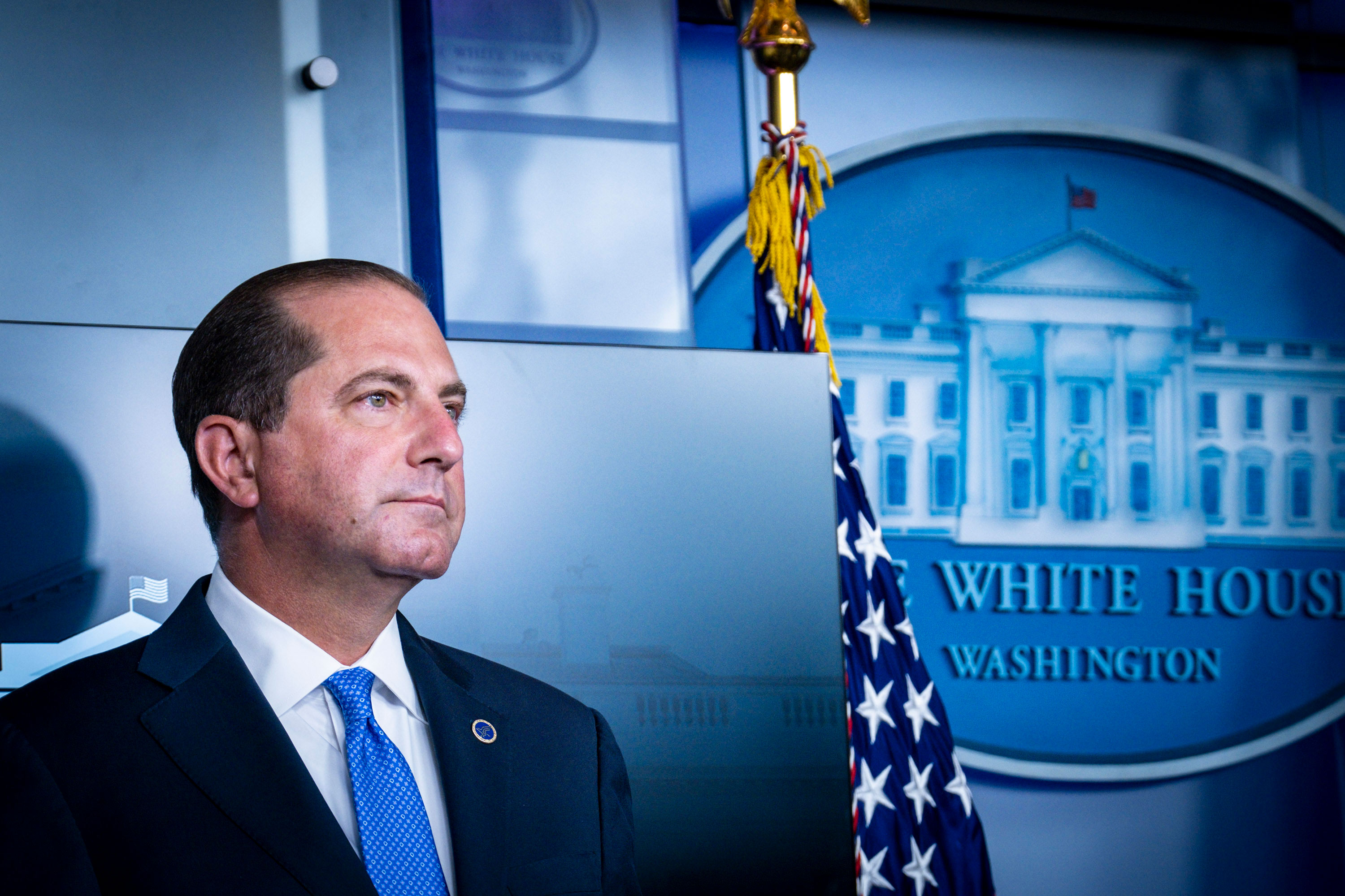 Alex Azar attends a press conference at the White House on August 23.