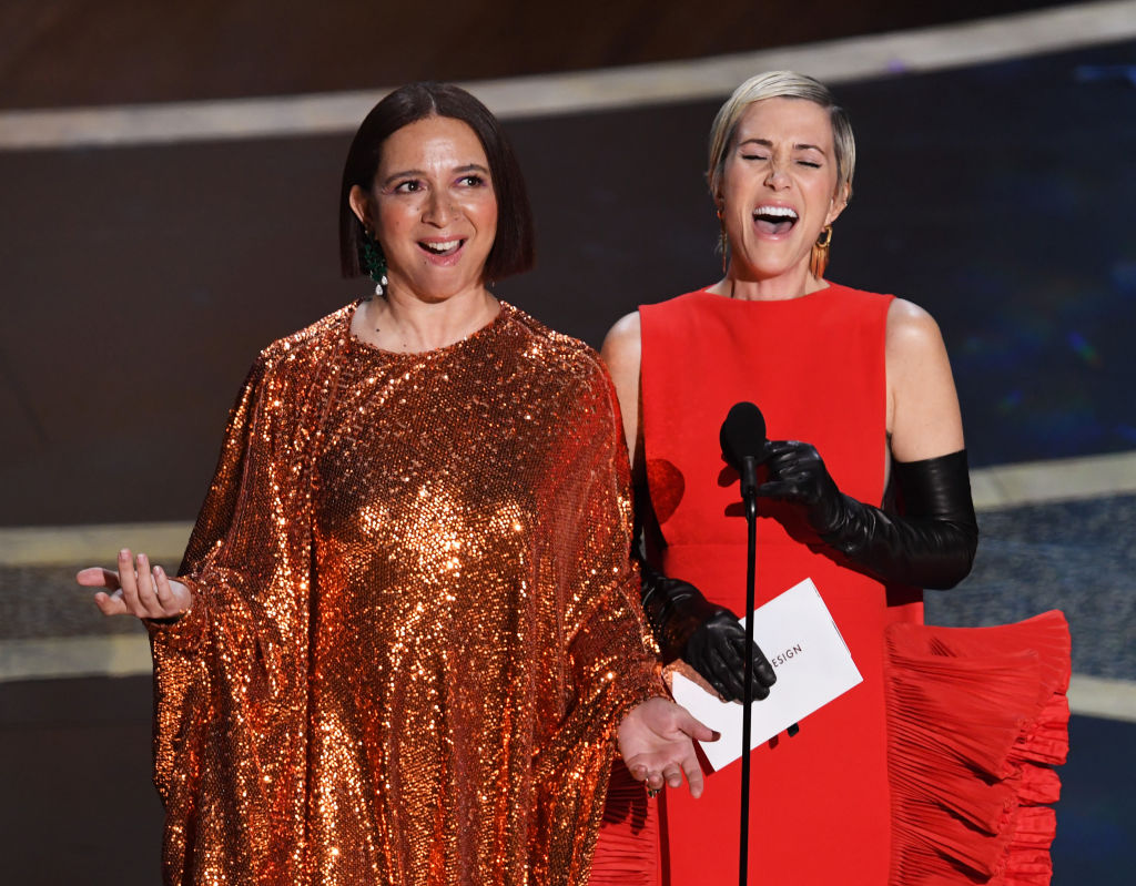 Maya Rudolph and Kristen Wiig speak onstage during the 92nd Annual Academy Awards at Dolby Theatre on Feb. 9, 2020 in Hollywood, California.