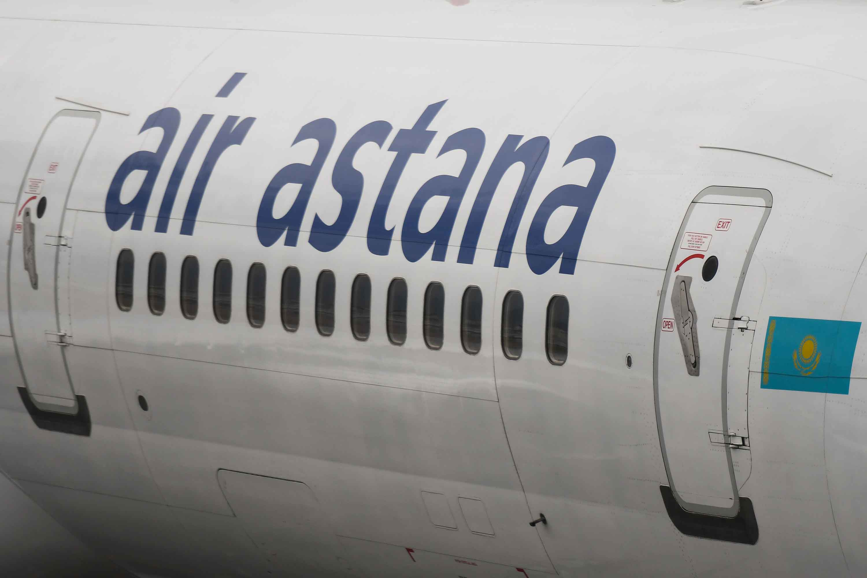 A plane belonging to Air Astana, the flag carrier of the Republic of Kazakhstan, is seen parked in Hong Kong International Airport in June 2019.