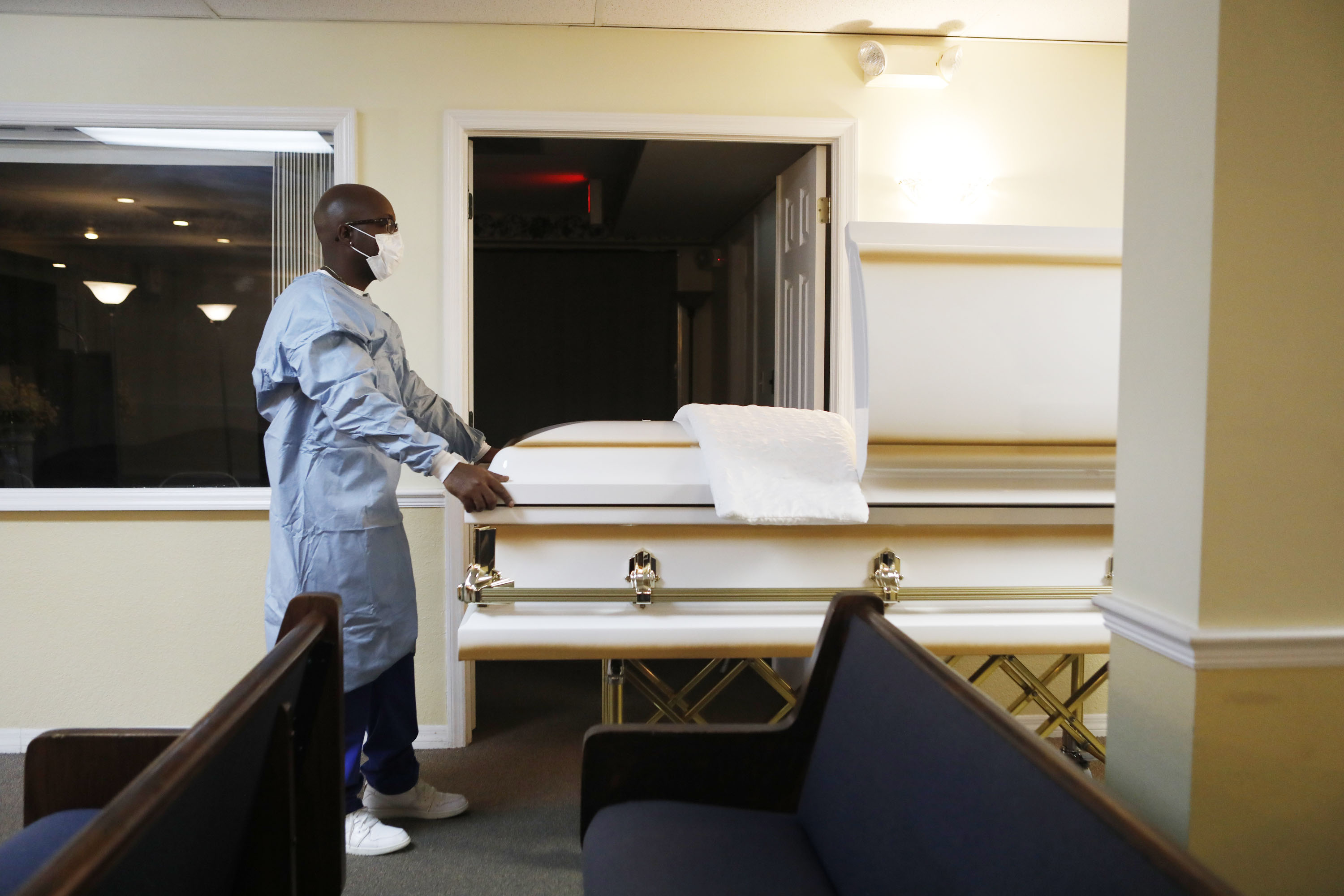 A mortician assistant prepares a funeral service for someone said to have died from Covid-19 at Ray Williams Funeral Home in Tampa, Florida, on August 12.