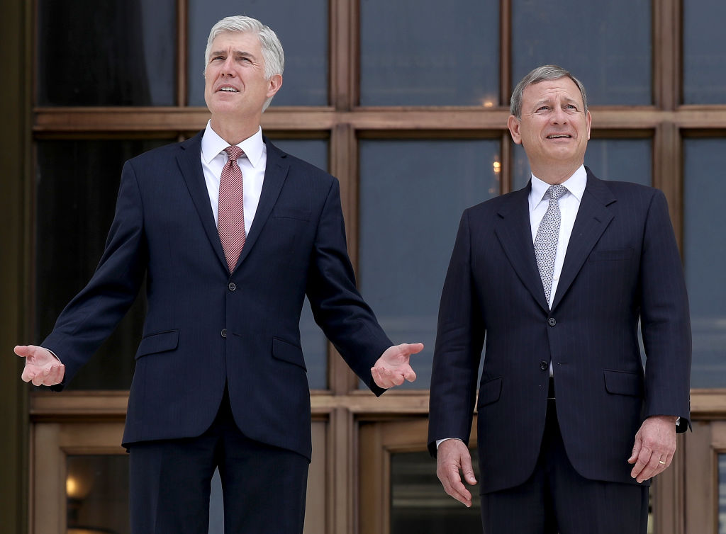 Supreme Court Justice Neil Gorsuch (L) talks with Chief Justice John Roberts (R) on the steps of the Supreme Court on June 15, 2017 in Washington, DC.