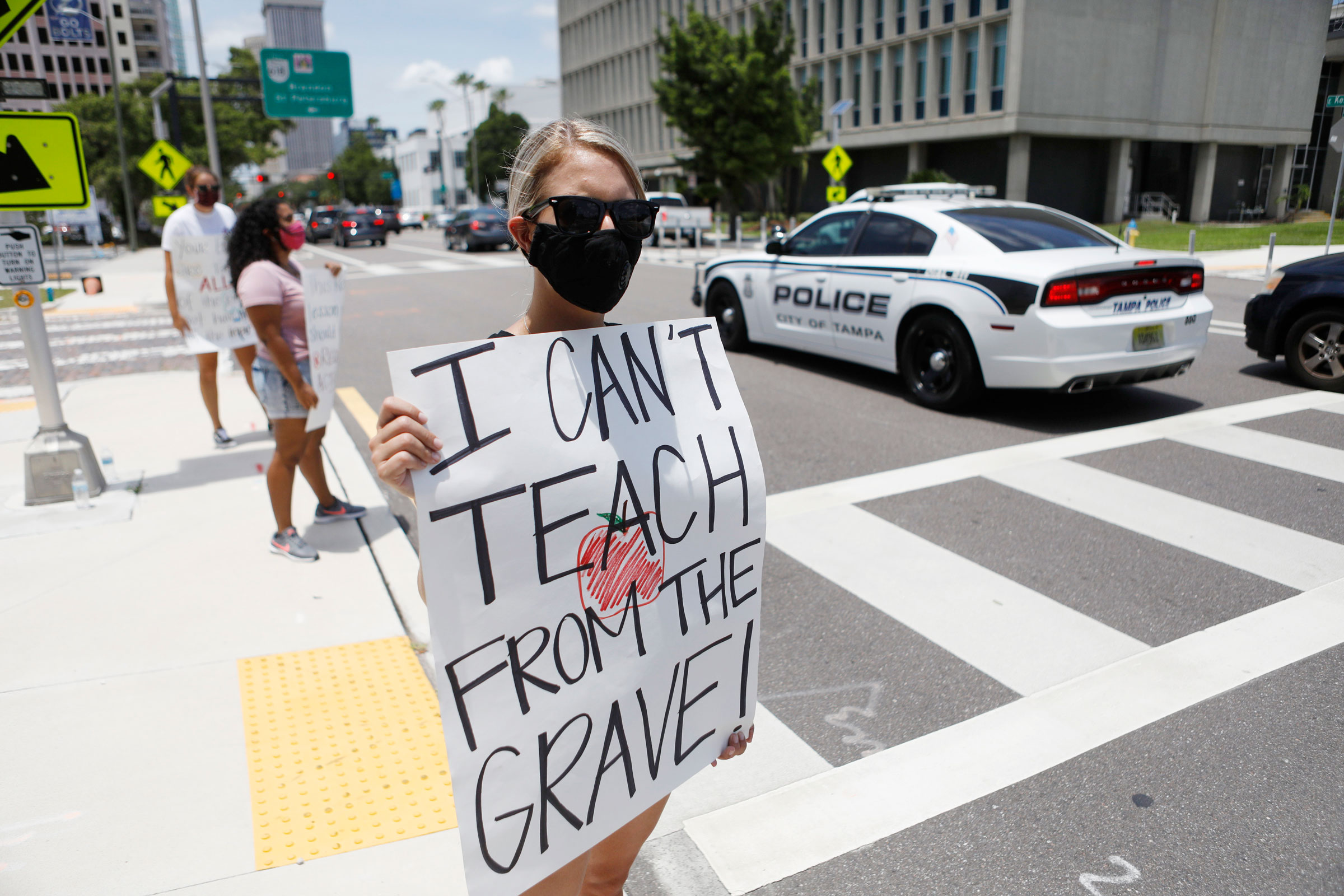 Middle-school teacher Brittany Myers takes part in a protest Thursday in front of the Hillsborough County Schools District Office in Tampa, Florida.