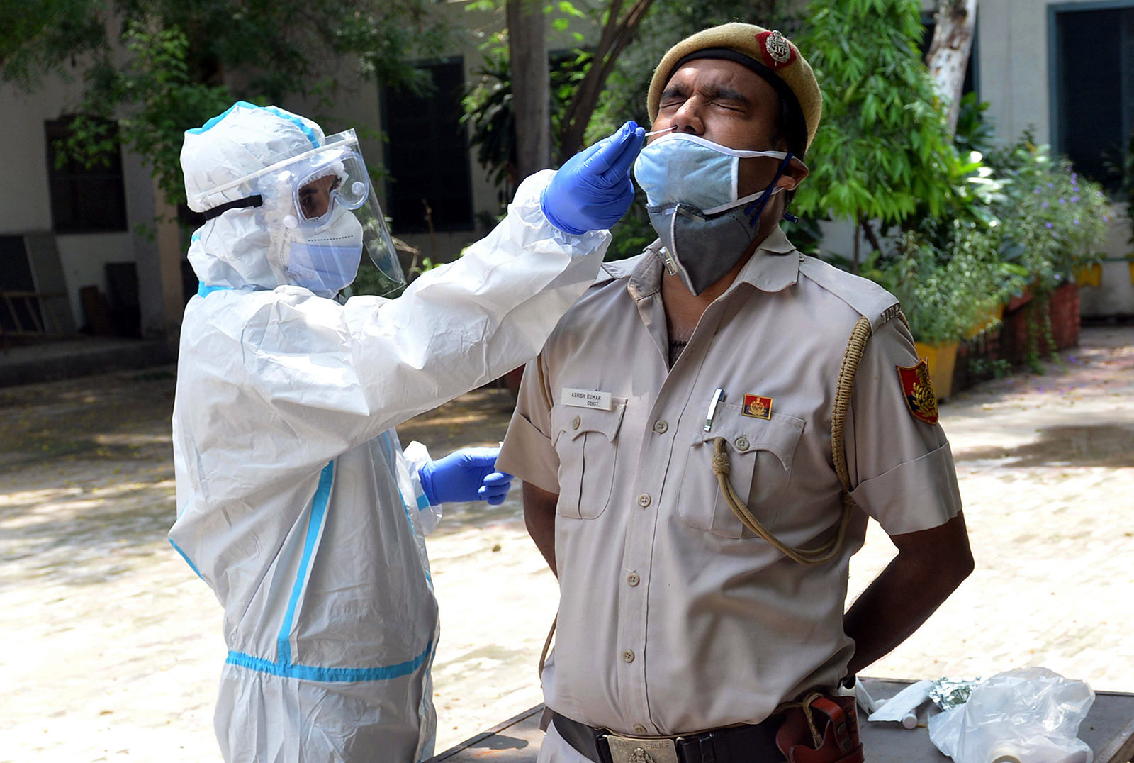 A health worker collects a sample for Covid-19 testing from a police officer in New Delhi, India on August 2.