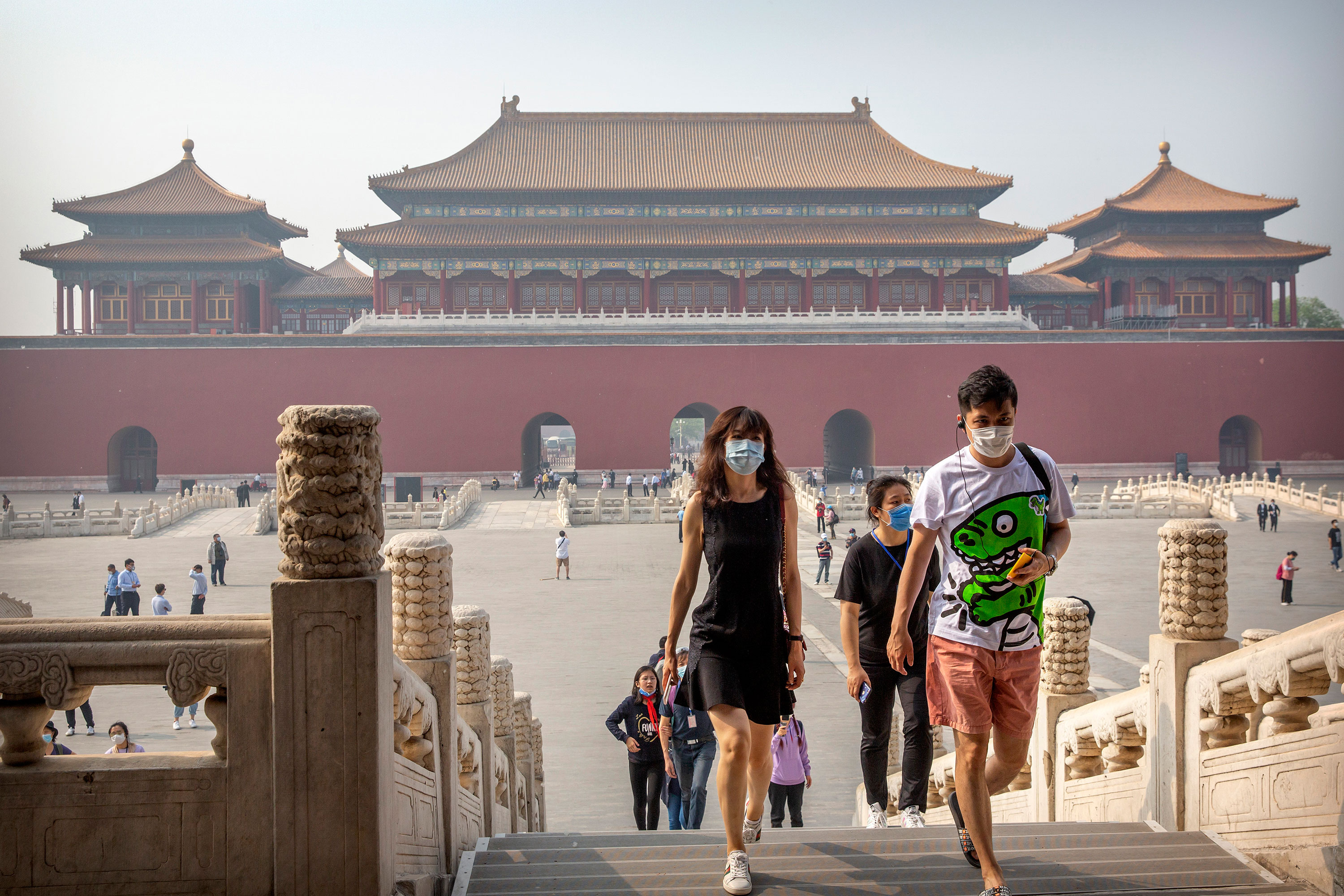 Visitors wearing face masks to protect against the new coronavirus walk through the Forbidden City in Beijing, May 1.