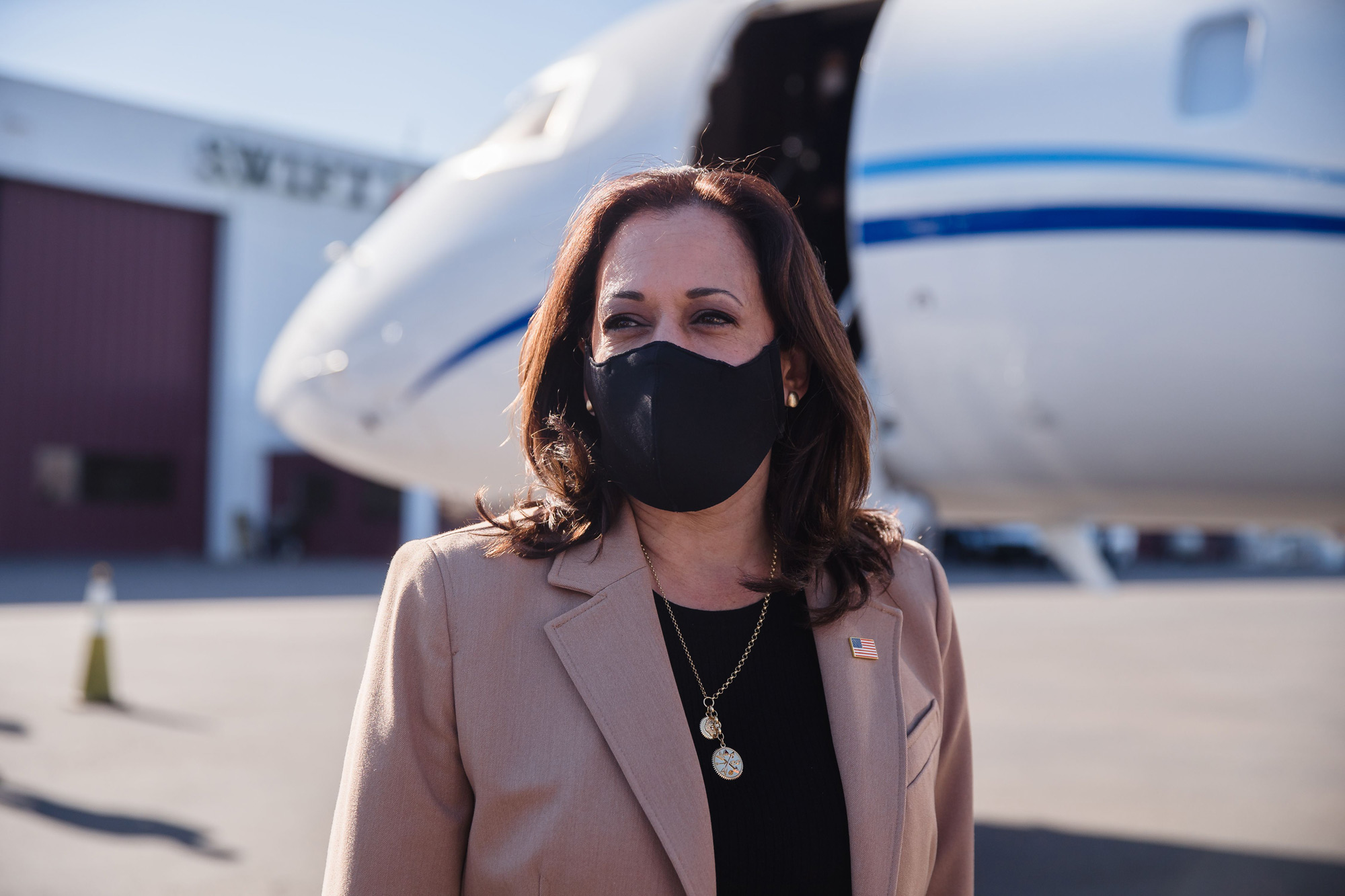 Democratic vice presidential nominee Kamala Harris speaks to the media as she arrives at Phoenix airport ahead of a campaign rally in Phoenix, Arizona on October 28.