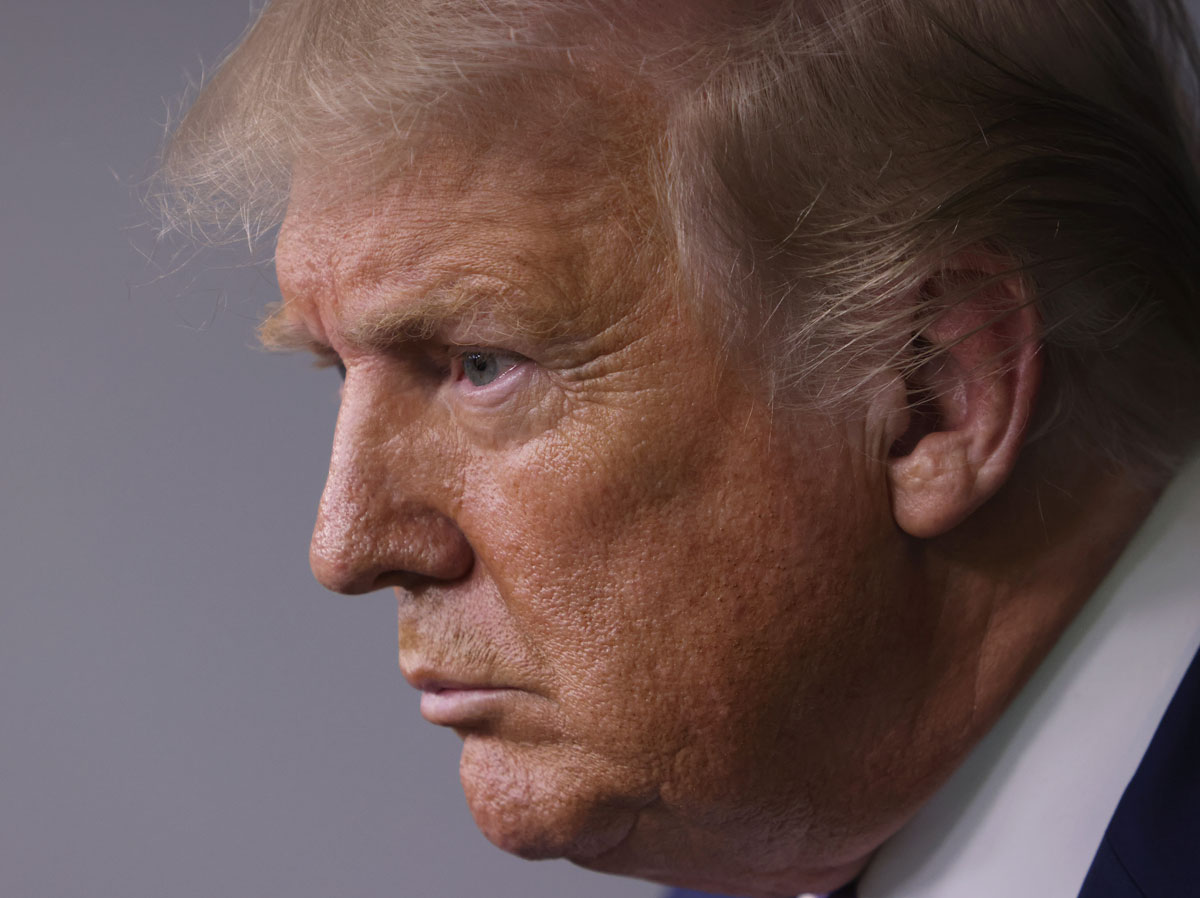 Former US President Donald Trump listens to a question during a news conference in the James Brady Press Briefing Room of the White House on August 5, 2020 in Washington, DC.