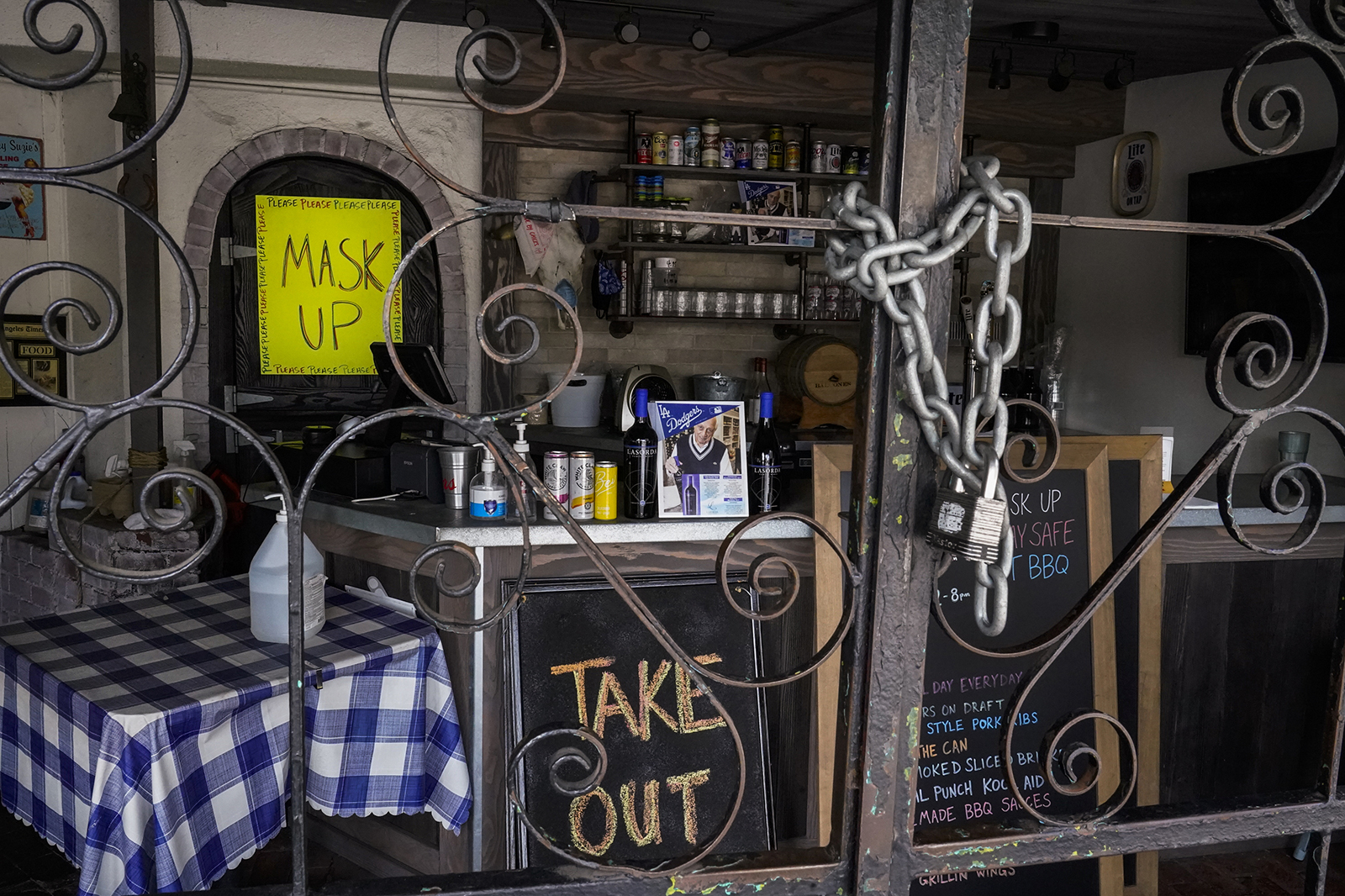 The doors of the Baby Blues BBQ restaurant are seen locked in Los Angeles Monday, January 25.