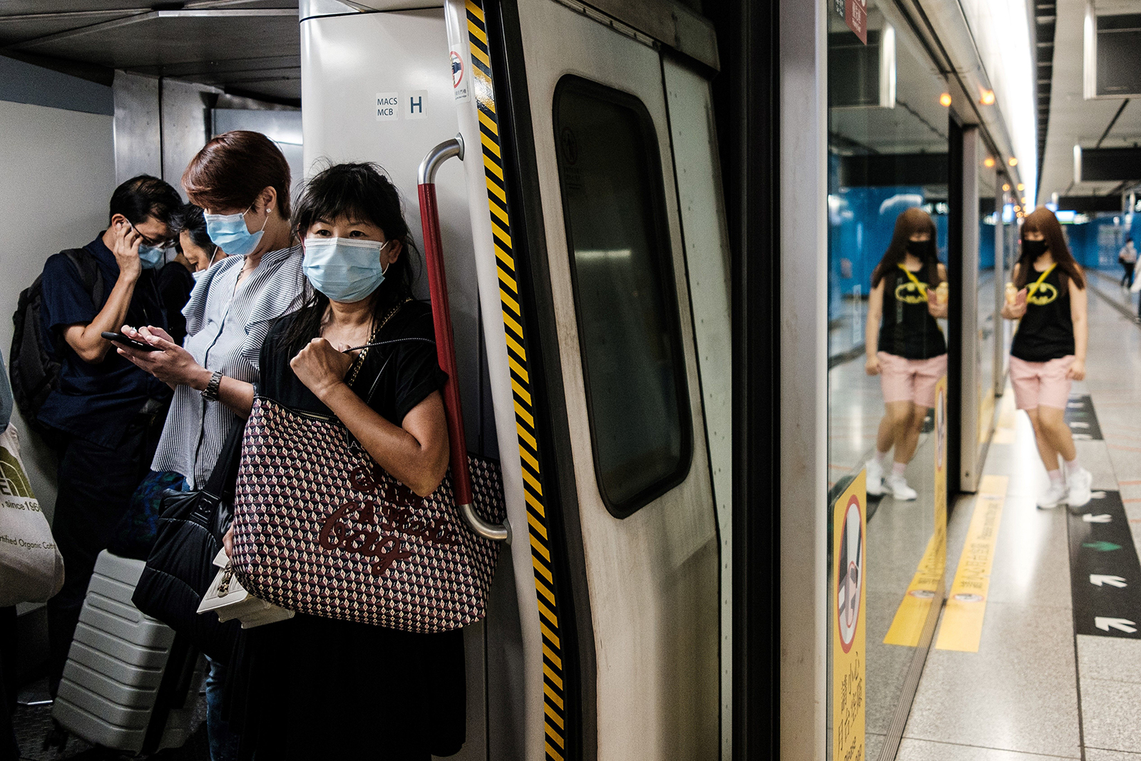 Commuters wear face masks on a metro train in Hong Kong on July 15.