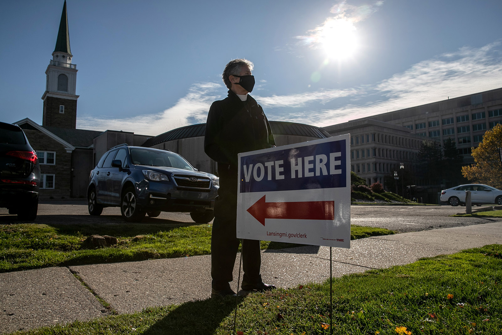 Poll observer Sue Carter stands near a polling place while watching for potential voter intimidation on Tuesday in Lansing, Michigan.