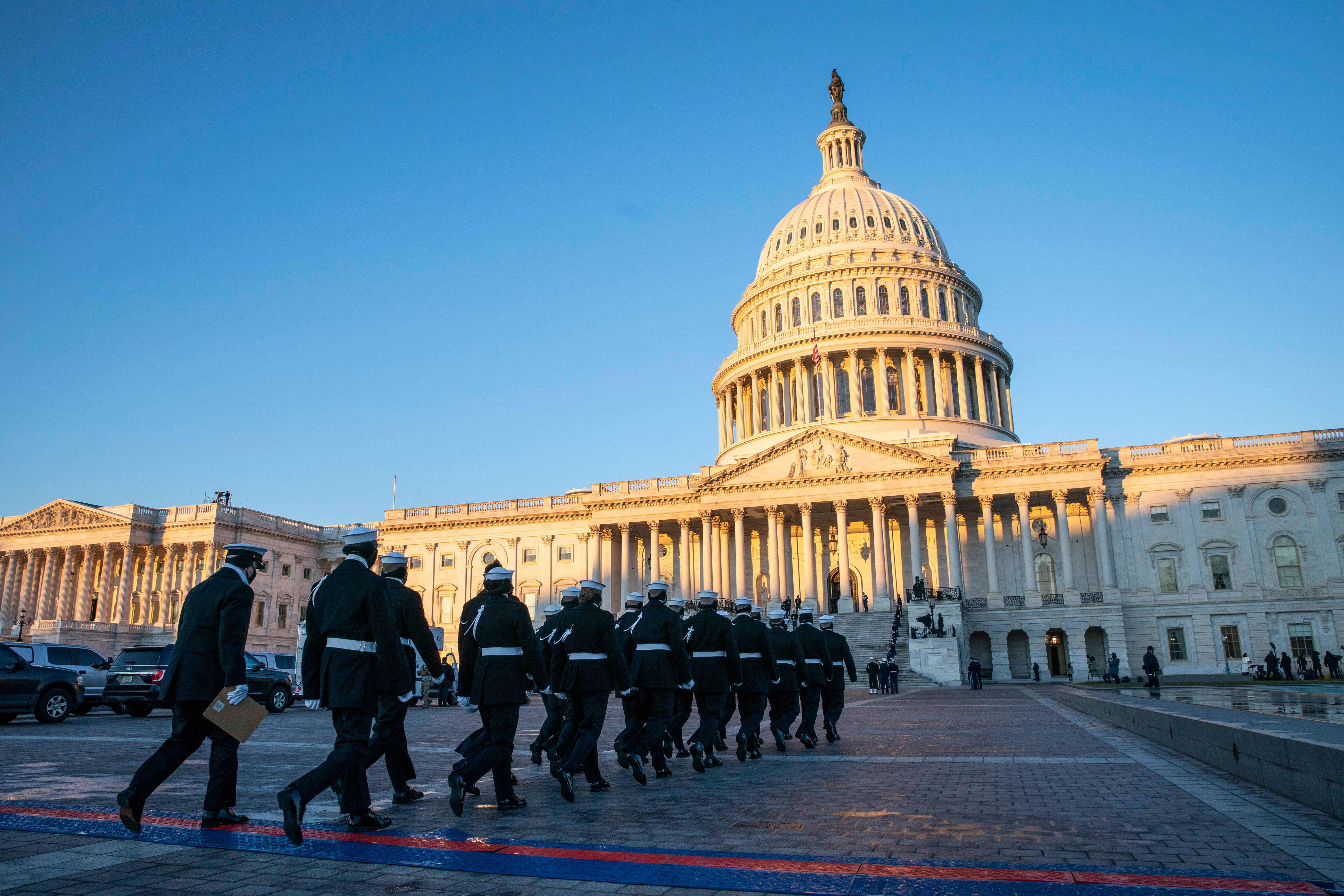 Members of the honor guard practice at sunrise for a presentation at Joe Biden's inauguration in Washington, DC, on January 20.