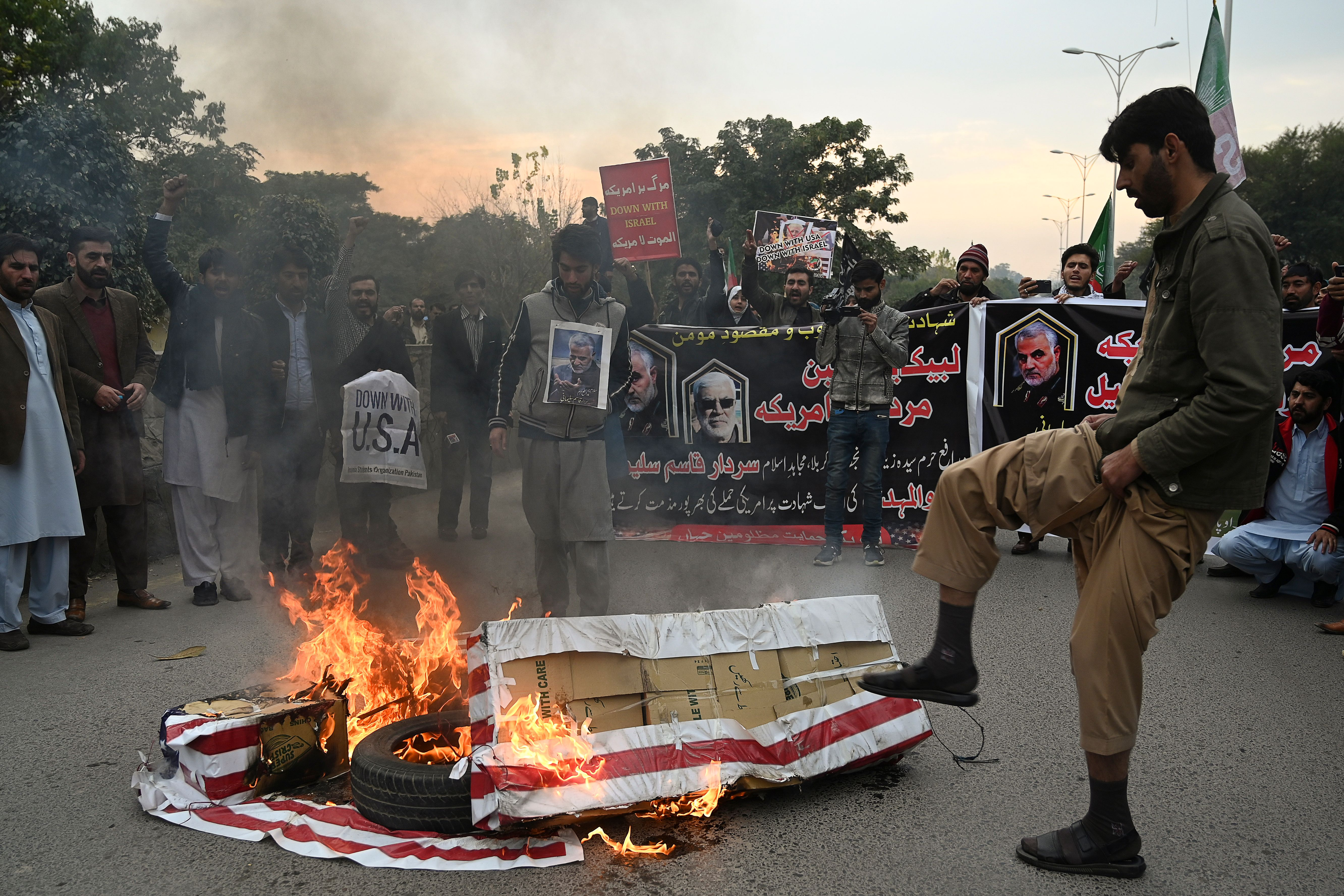 Protesters burn US flags during a demonstration in Islamabad, Pakistan, following the airstrike that killed Soleimani on Friday. Credit: Aamir Qureshi/AFP via Getty Images