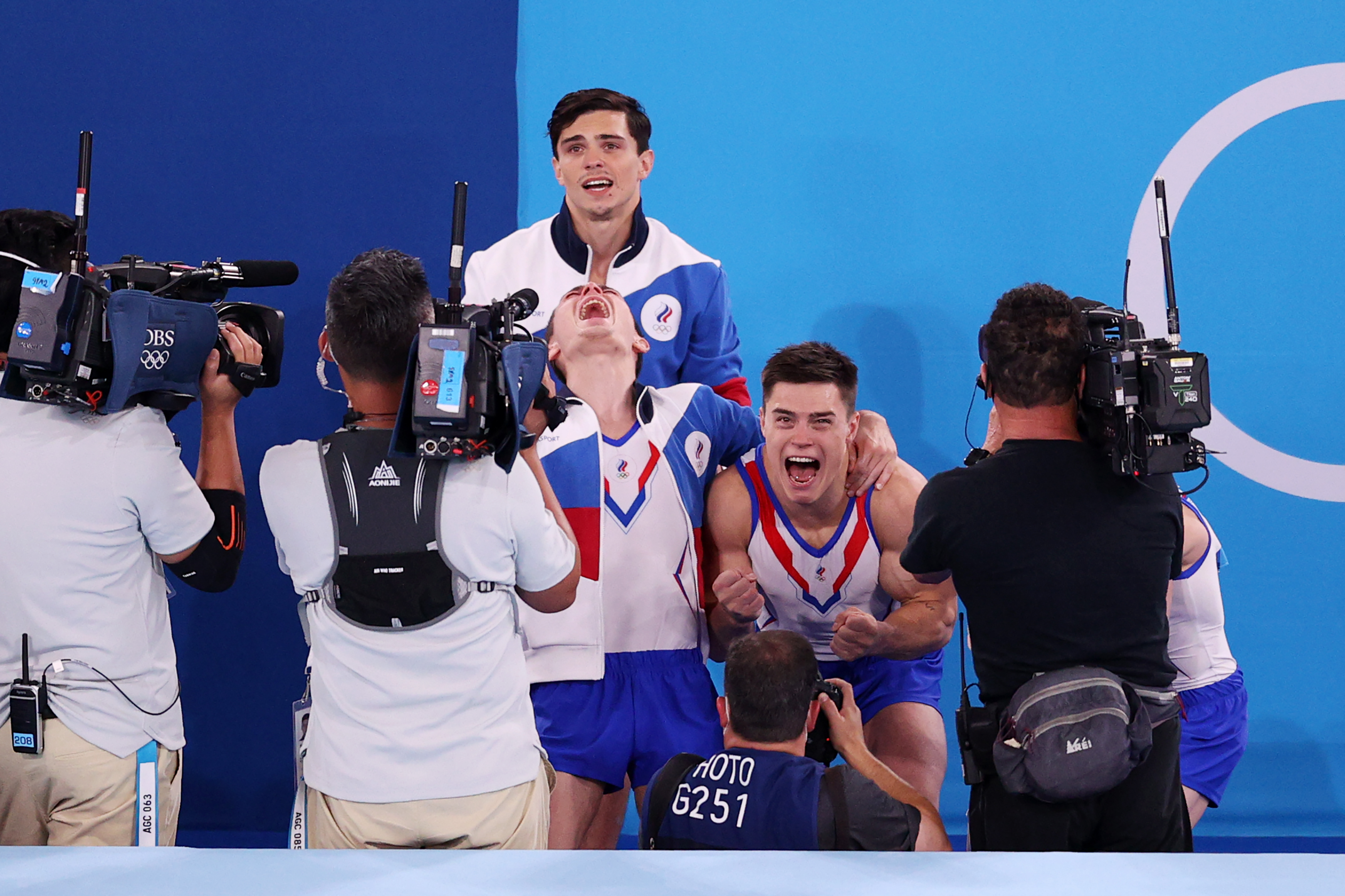 The Russian Olympic Committee celebrates after winning gold during the Men's Team Final on July 26.