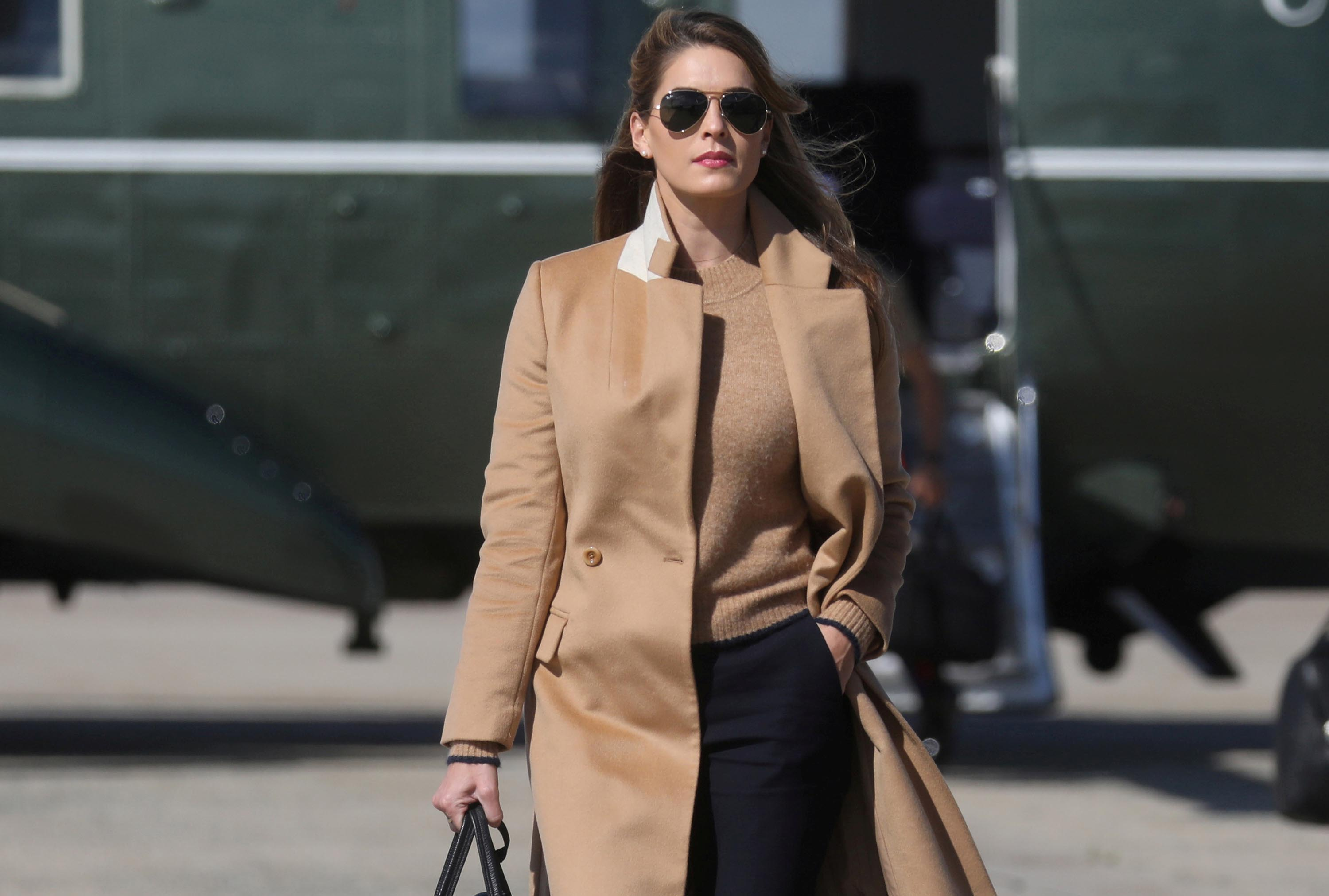 Hope Hicks, an adviser to US President Donald Trump, walks to Air Force One to depart with the President and other staff on campaign travel to Minnesota from Joint Base Andrews, Maryland, on Wednesday, September 30.