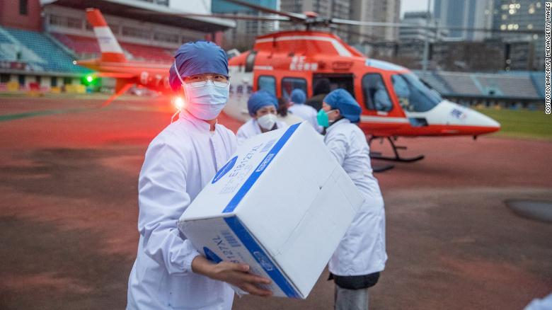 Medical staff carry supplies from a helicopter in Wuhan, China, on February 1, 2020.