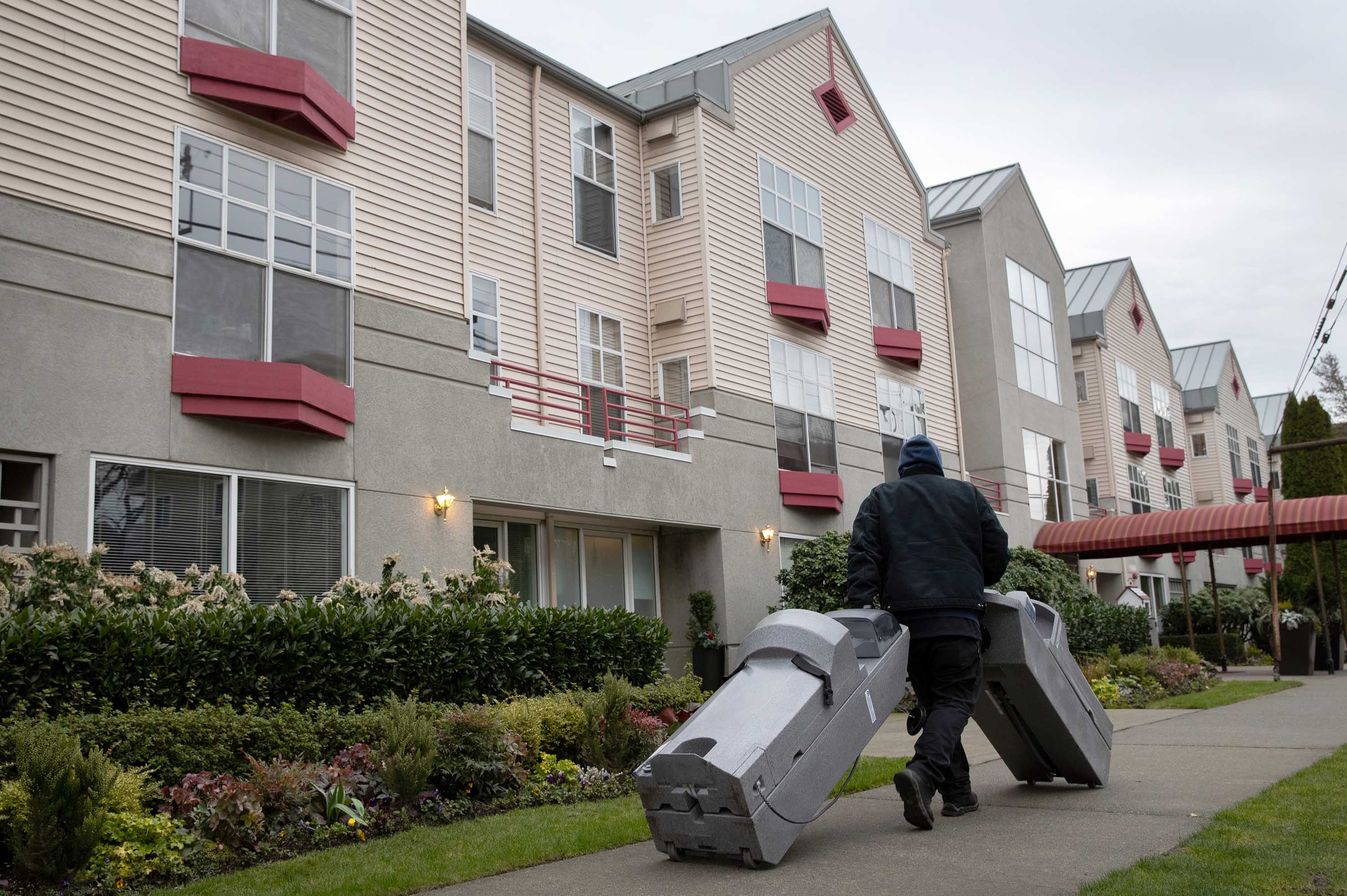 Hand washing stations are delivered to the Ida Culver House Ravenna retirement community in north Seattle, Washington, on Tuesday. A resident of the center who had been hospitalized and then tested positive for coronavirus reportedly died Monday.