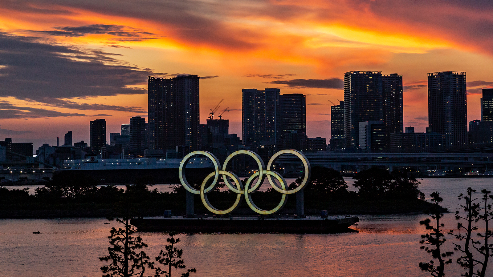 Olympic rings are seen at sunset on July 21, in Tokyo, Japan.