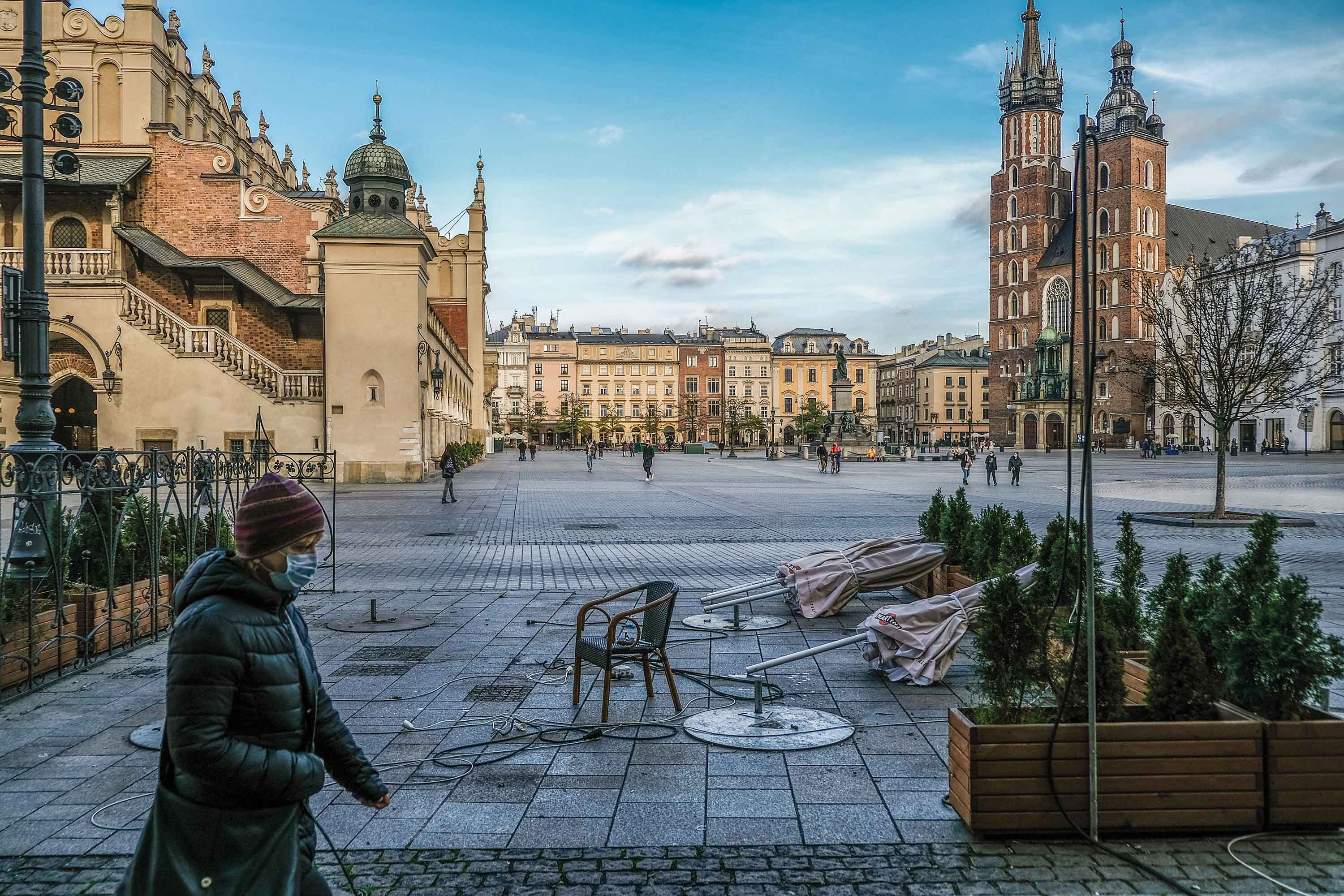 A person walks in Krakow's nearly empty main square, during the Covid-19 crisis in Poland, on November 16.