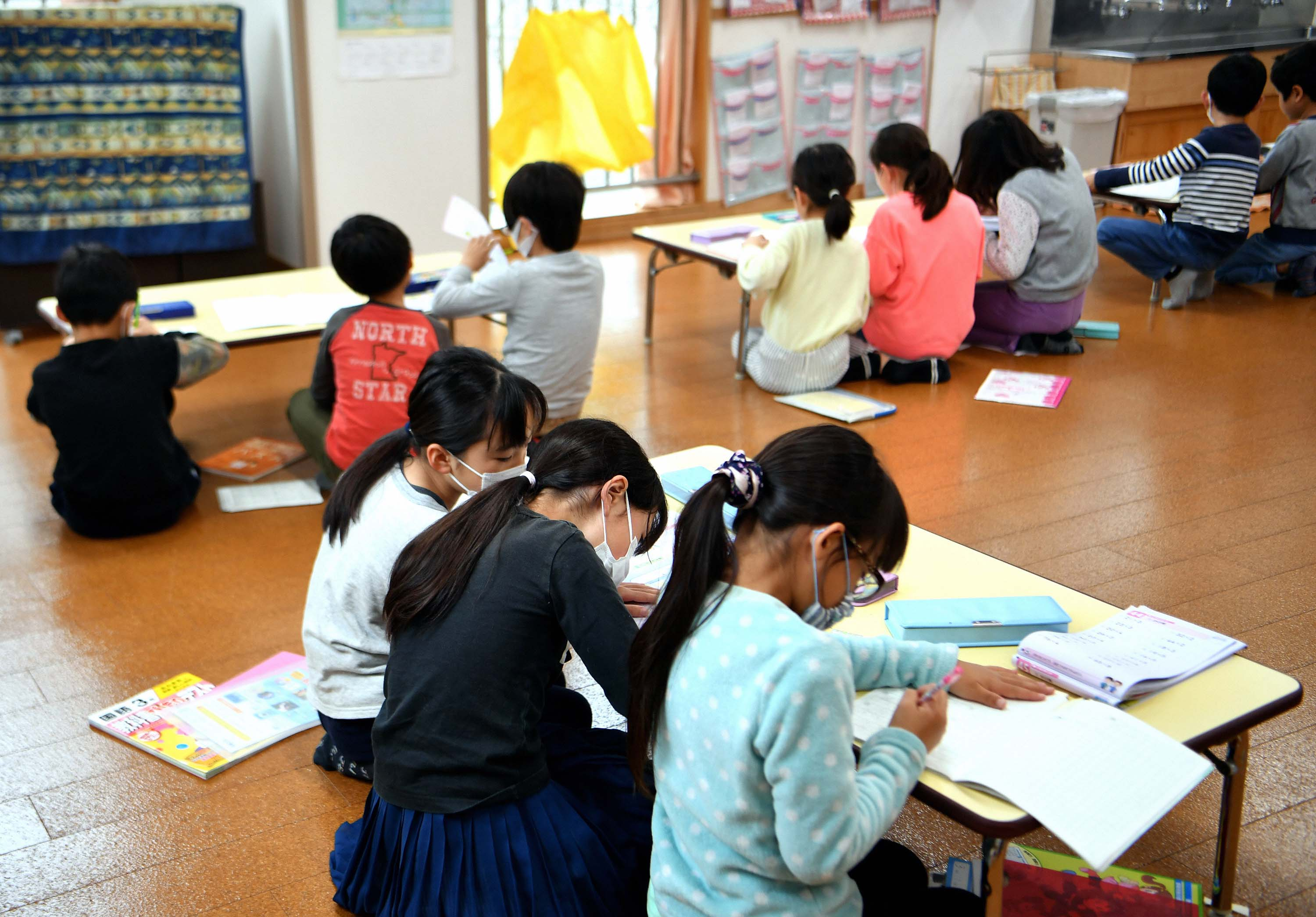 Children study at a community center after schools closed in Tokyo, Japan on March 2. Prime Minister Shinzo Abe asked that Japanese schools remain closed until later this month, as an emergency measure to contain the spread of the coronavirus.