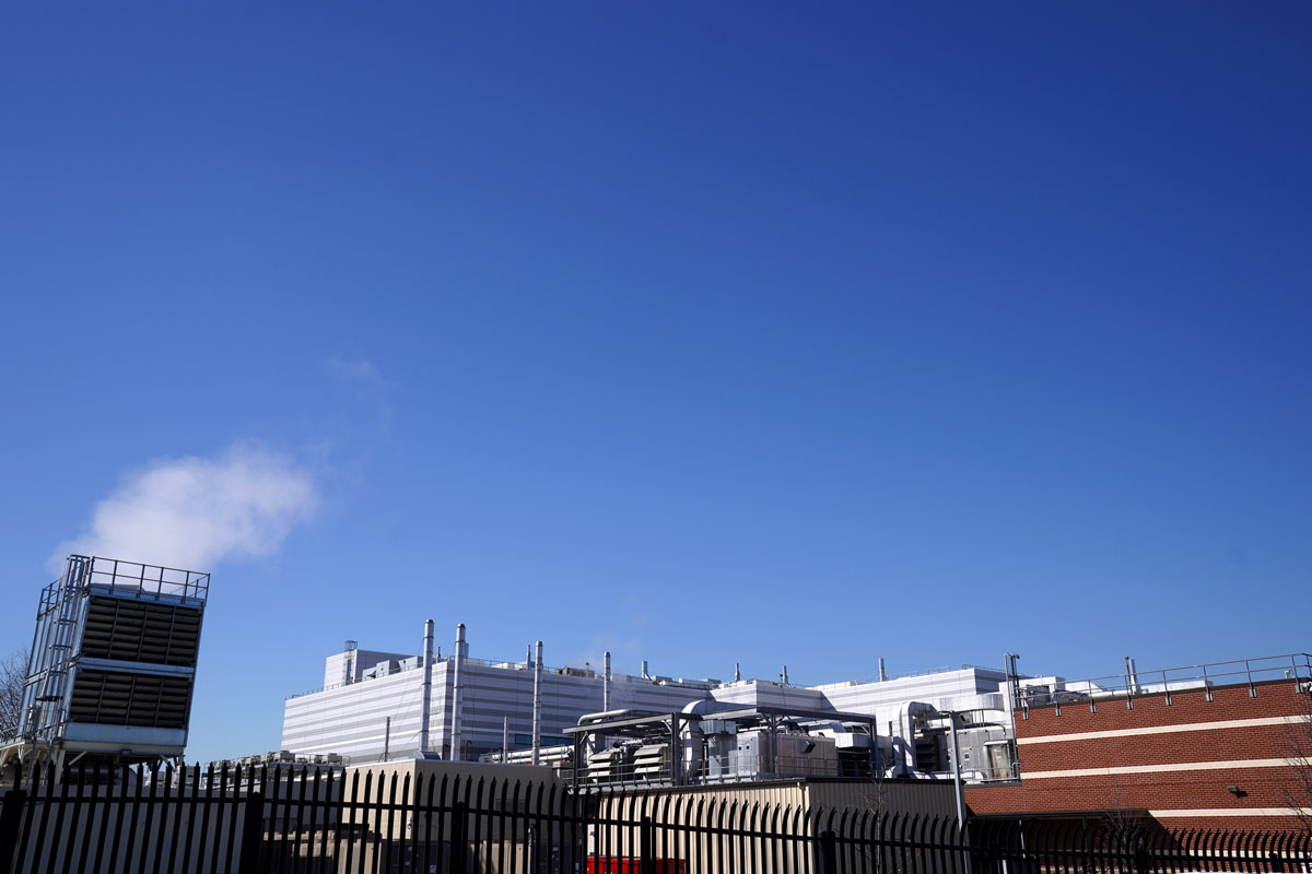 The offices and manufacturing facility of Emergent Biosolutions, which manufactured vaccines for AstraZeneca and Johnson & Johnson, are seen through a security fence on February 8 in Baltimore, Maryland.