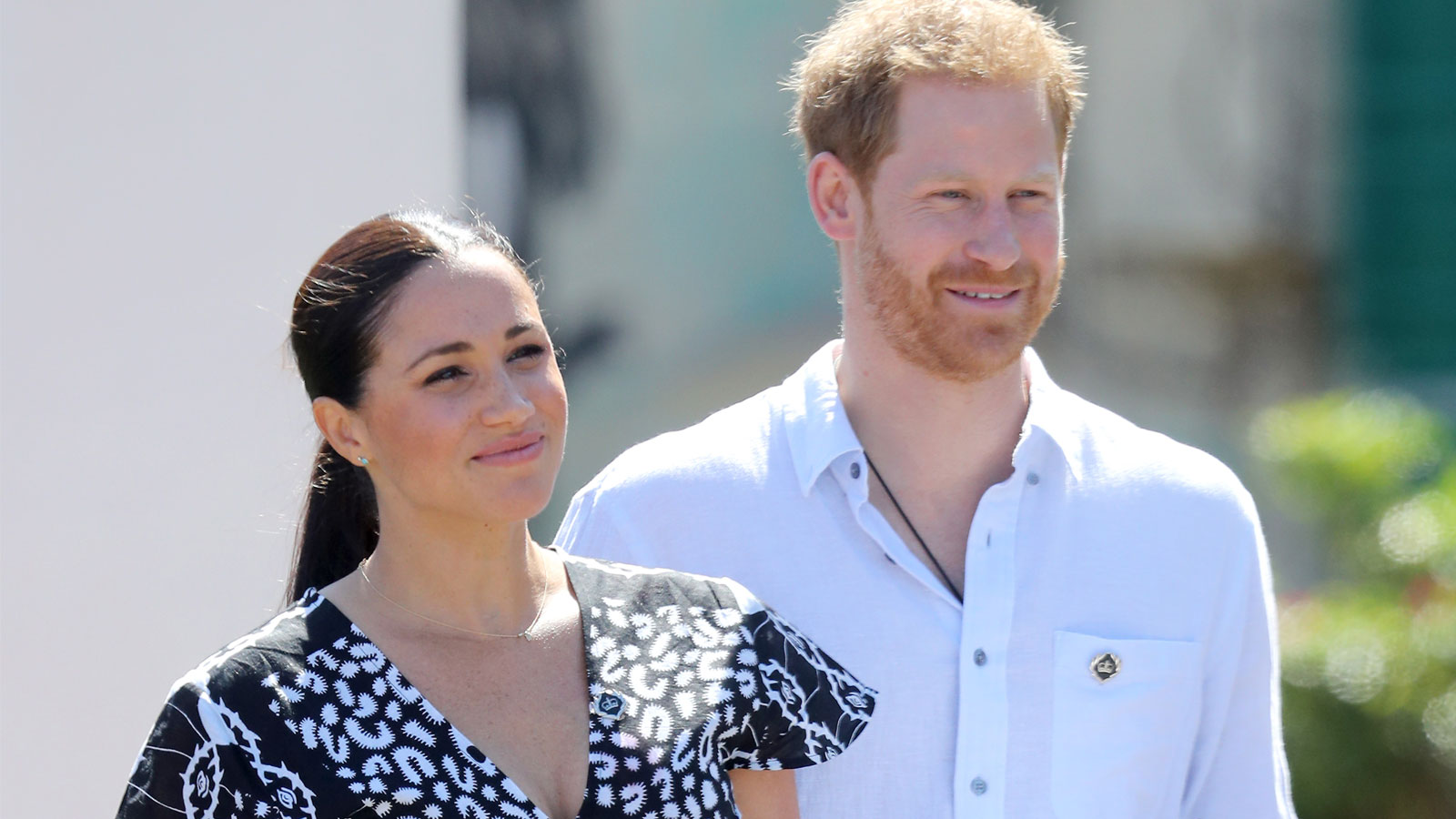 Meghan and Harry smile as they visit a Justice Desk initiative in Nyanga township, during their royal tour of South Africa on Monday.