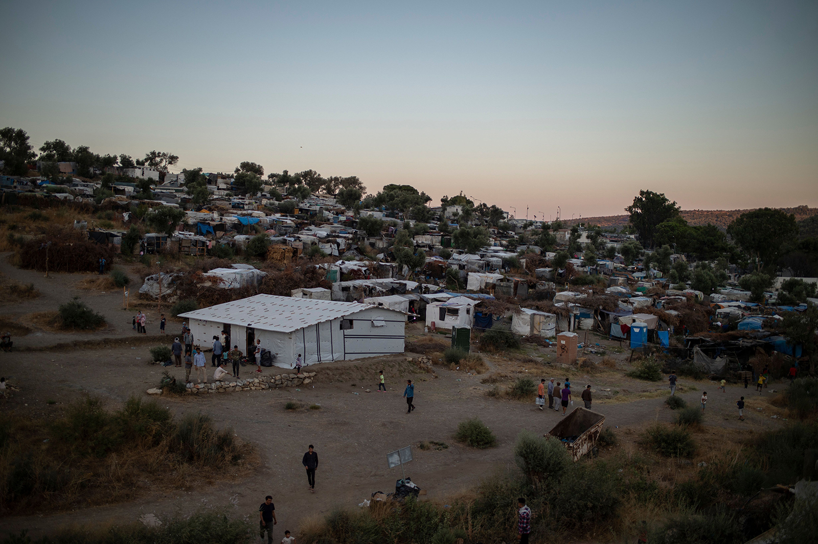 This photo taken on August 24 shows a part of the makeshift camp next to the refugee camp of Moria, in the island of Lesbos.