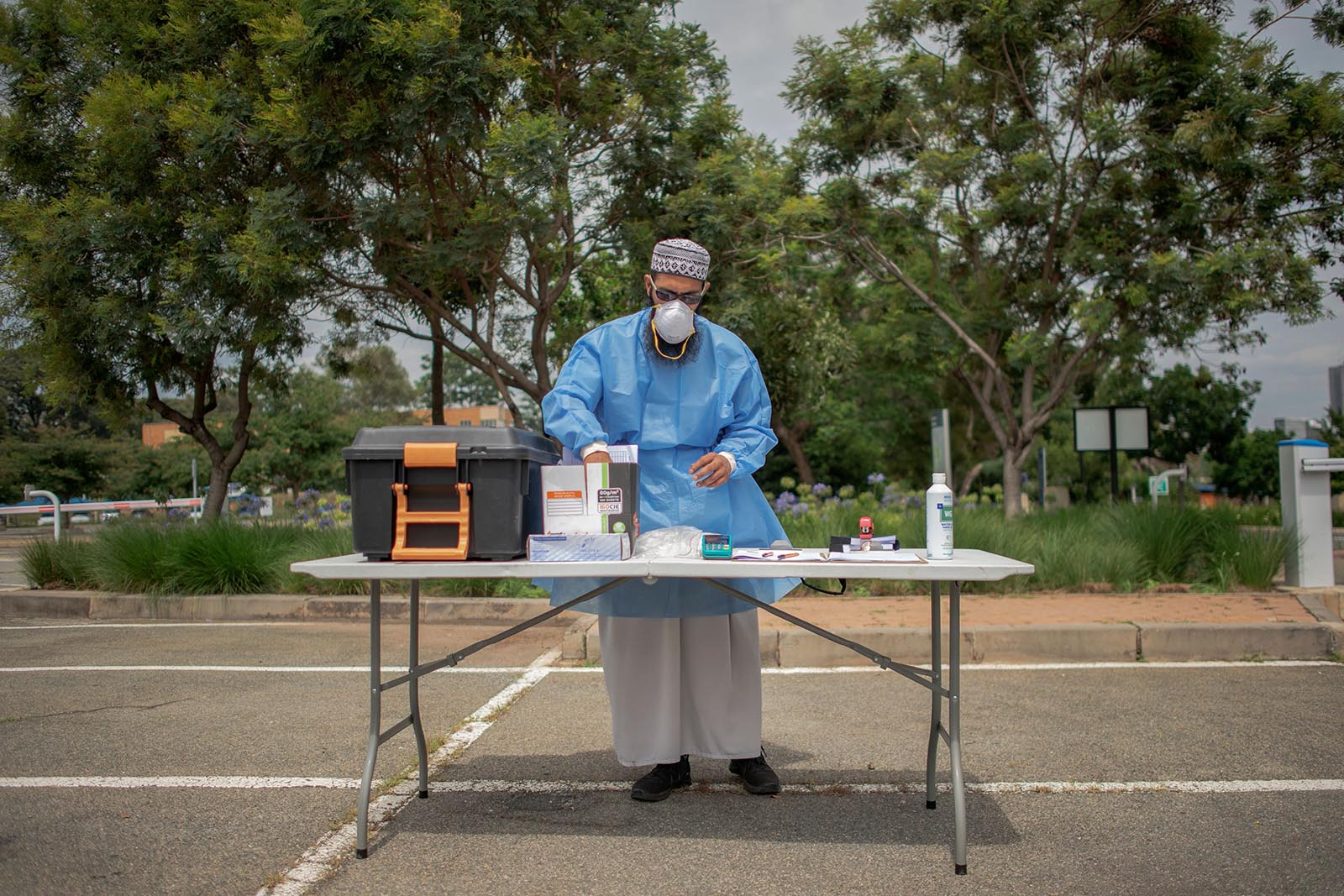 A lab technician prepares equipment to perform Covid-19 swab tests at a drive-through testing center at Wits University, Johannesburg, on January 5.