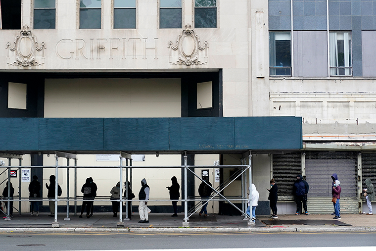 People wait in a line to get tested for Covid-19 at an urgent care clinic in Newark, New Jersey, on October 26.