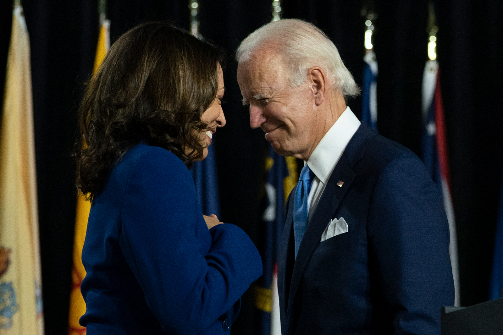 In this Aug. 12, file photo, Democratic presidential candidate former Vice President Joe Biden and his running mate Sen. Kamala Harris, D-Calif., pass each other in Wilmington, Del.