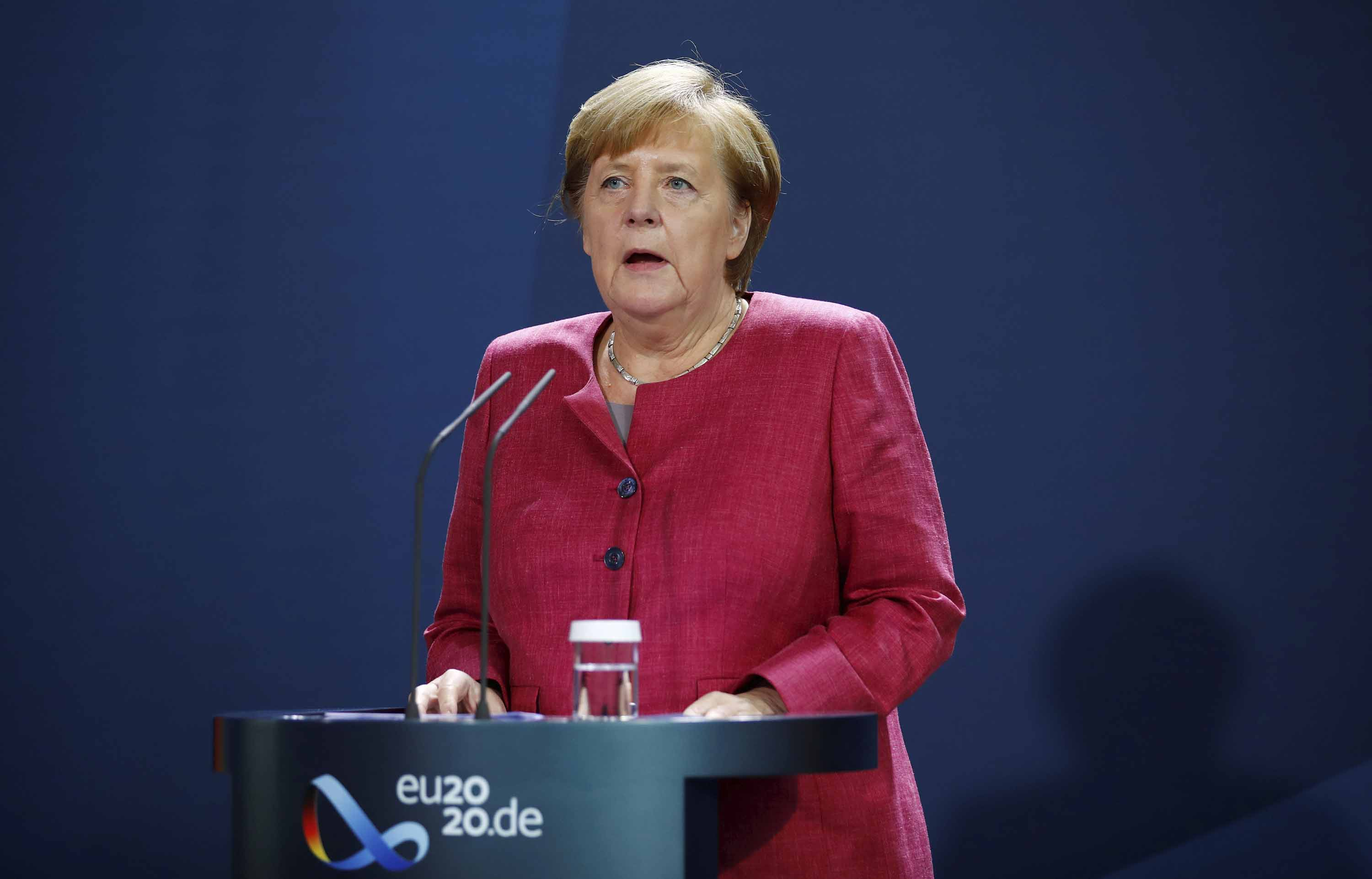 German Chancellor Angela Merkel gives a media statement in Berlin, following a video conference with mayors of German cities on the spread of the coronavirus Germany, on October 9.